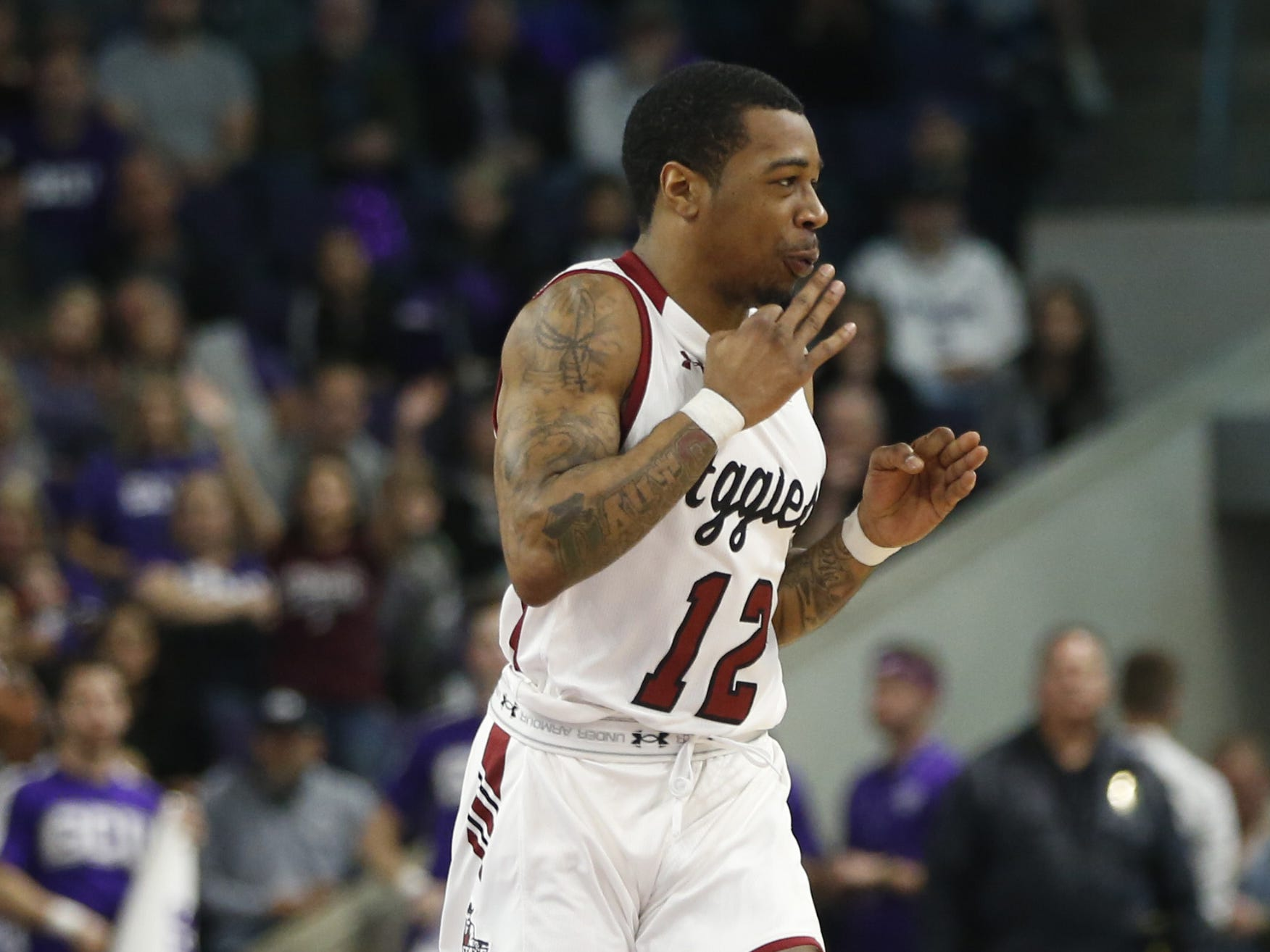 New Mexico State's AJ Harris (12) blows on his fingers after hitting a three against GCU during the first half at Grand Canyon University Arena in Phoenix, Ariz. on February 9, 2019.