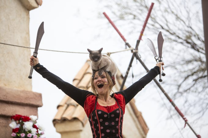 Melissa Arleth of Cirque du Sewer performs with her cat at the Arizona Renaissance Festival 2019 on Feb. 9, 2019 in Gold Canyon, Ariz.