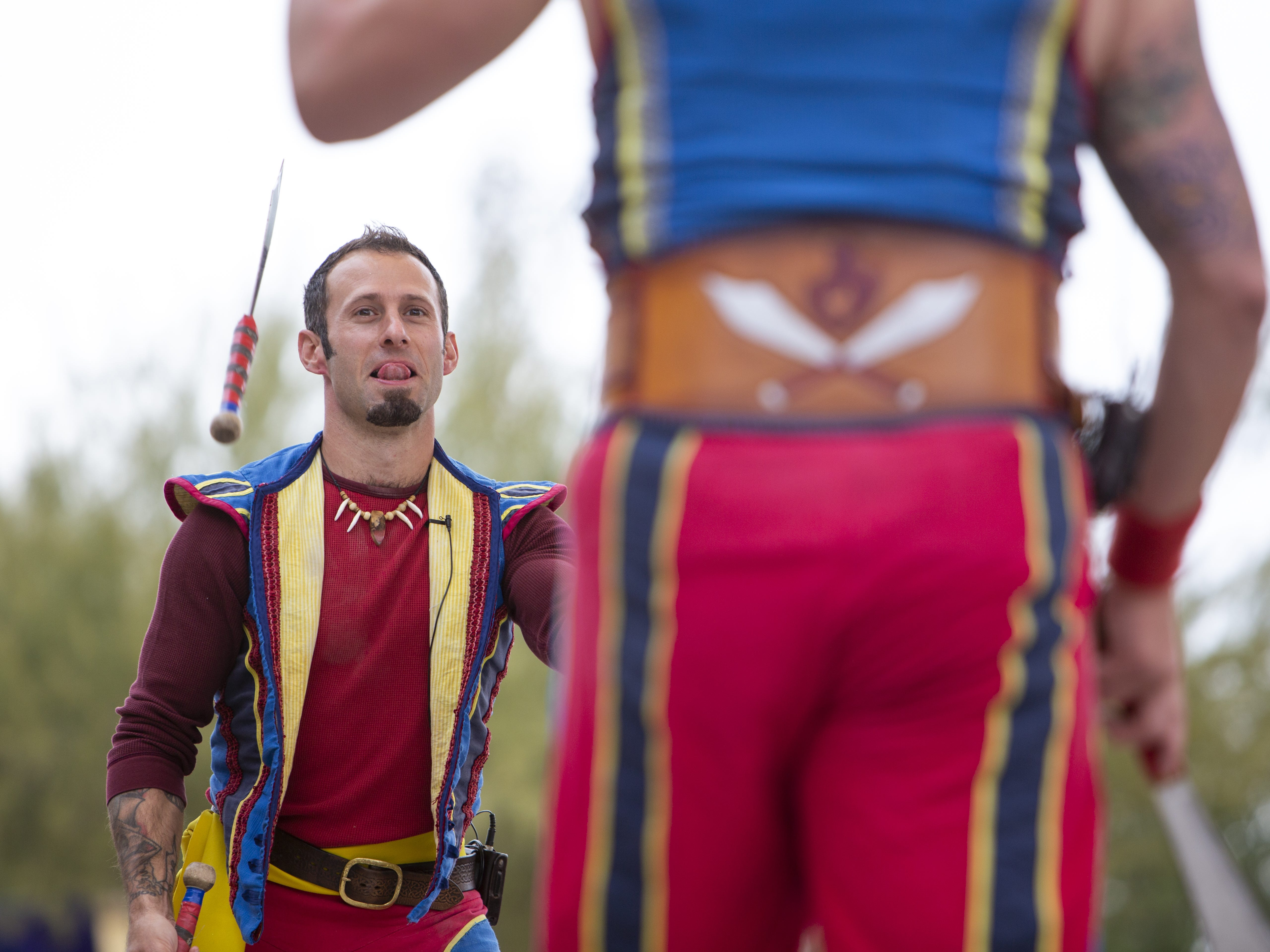 Cameron Tomele of the comedy circus group Barely Balanced juggles knives at the Arizona Renaissance Festival 2019 on Feb. 9, 2019 in Gold Canyon, Ariz.