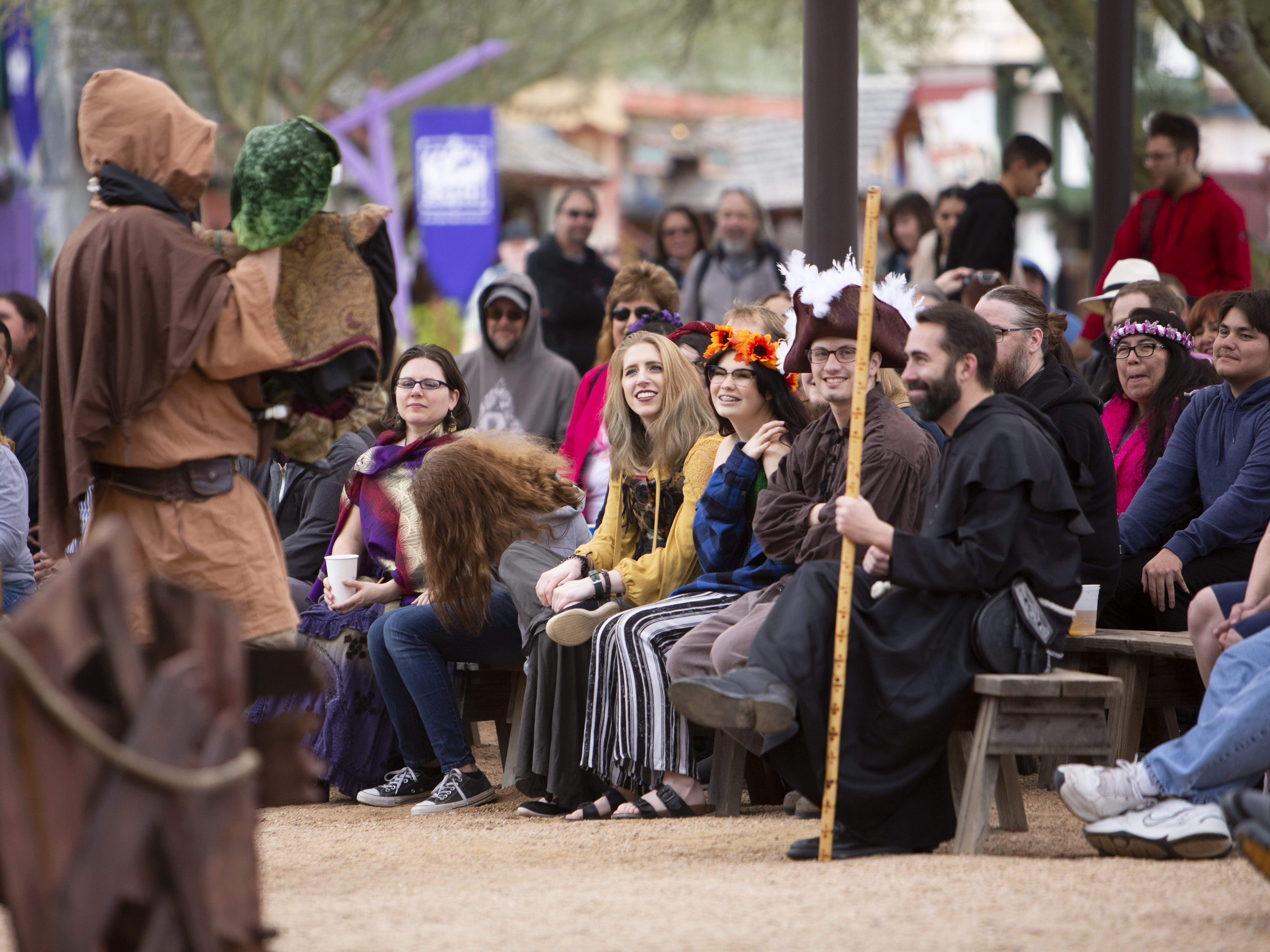 "The audience listens to a ""The Ded Bob Show"" at the Boathouse State at the Arizona Renaissance Festival 2019 on Feb. 9, 2019 in Gold Canyon, Ariz."