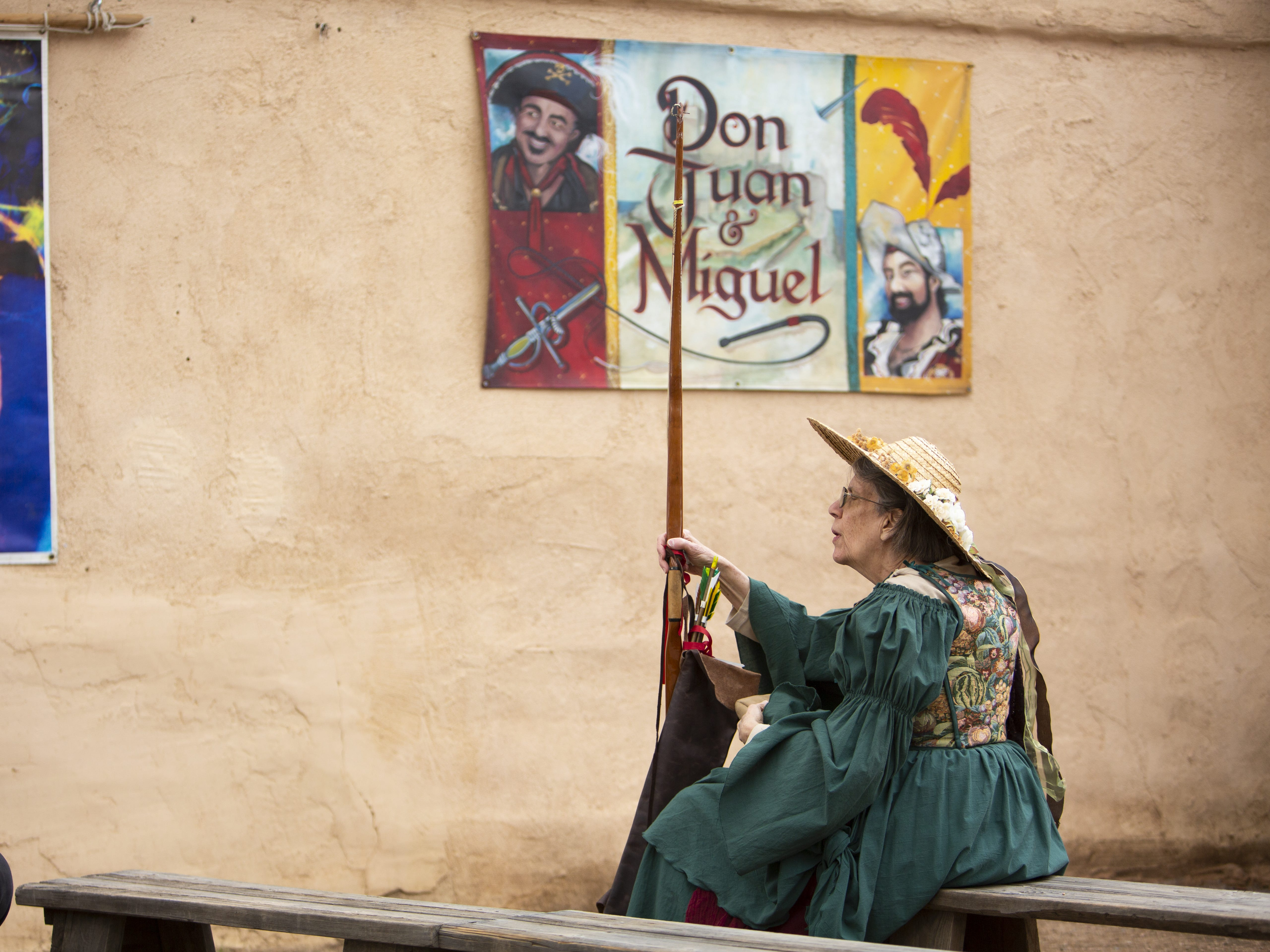 Dianna Barra talks to a neighbor as she waits for the Ghazaal Beledi world music and dance performance to begin at the Arizona Renaissance Festival 2019 on Feb. 9, 2019 in Gold Canyon, Ariz.