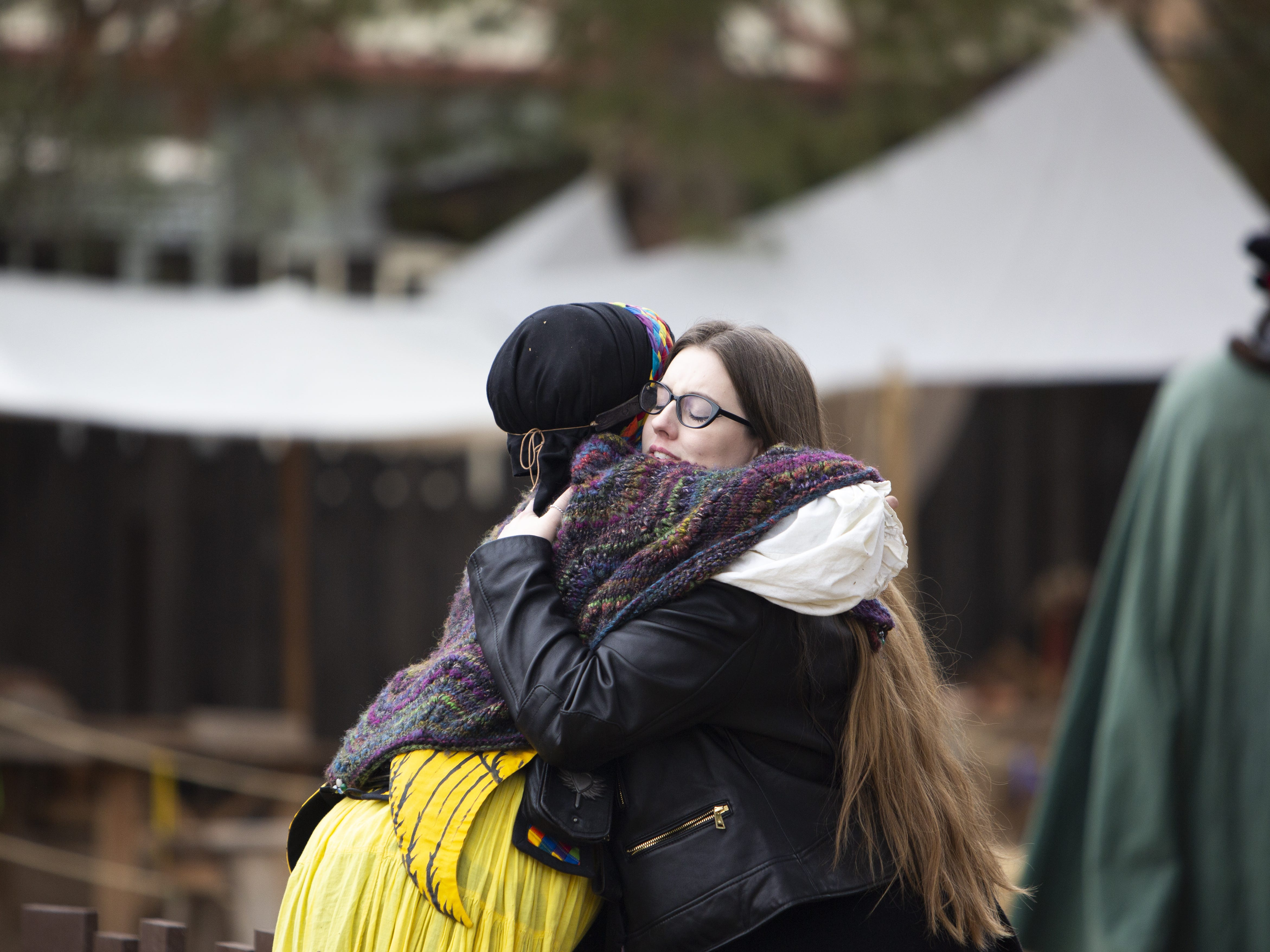 Esther Rose of The Angels: Heroines in Disguise, hugs her friend Andee Sparrow (right), at the Arizona Renaissance Festival 2019 on Feb. 9, 2019 in Gold Canyon, Ariz.