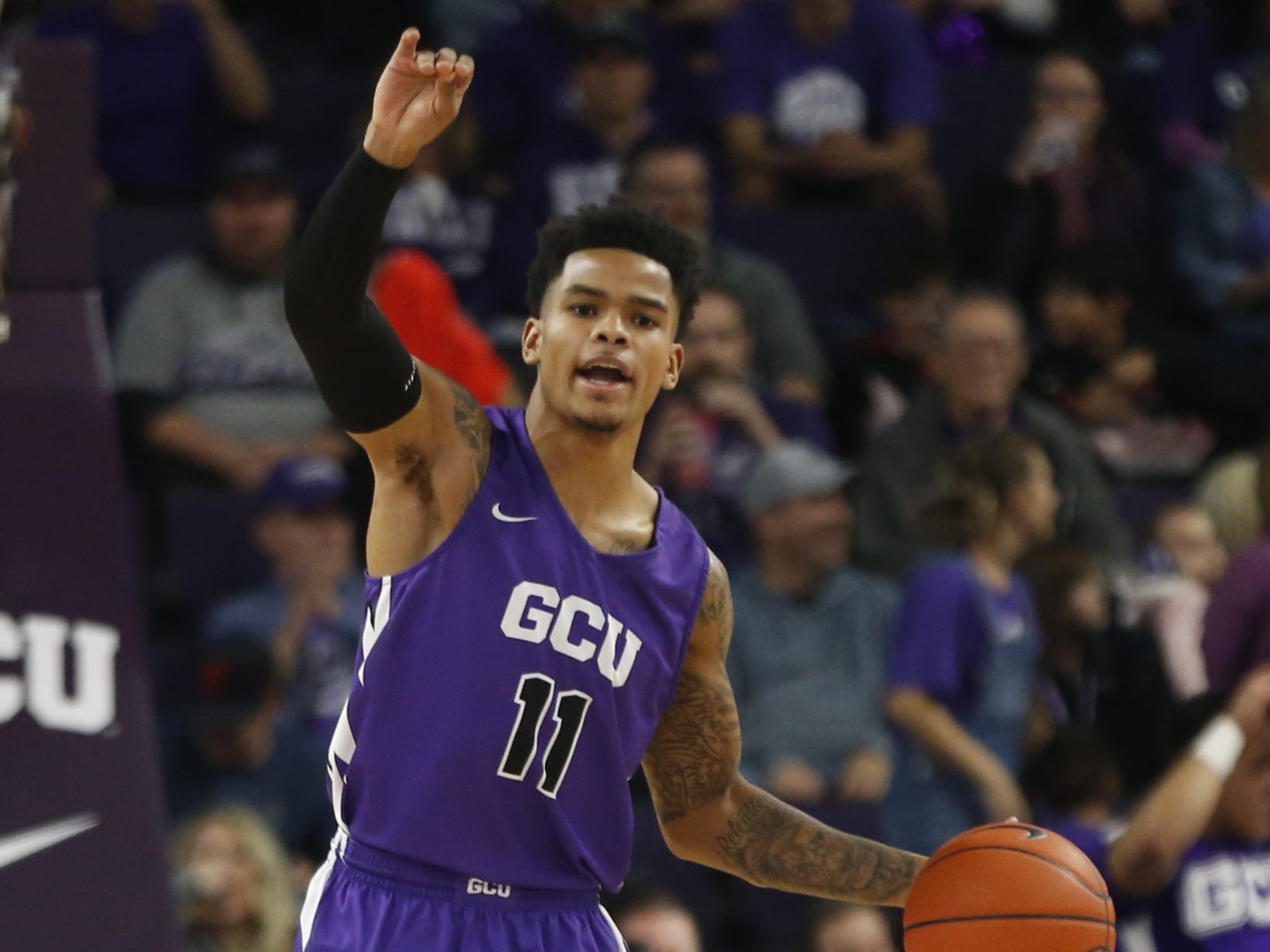 GCU's Damari Milstead (11) dribbles up the court against New Mexico State during the first half at Grand Canyon University Arena in Phoenix, Ariz. on February 9, 2019.