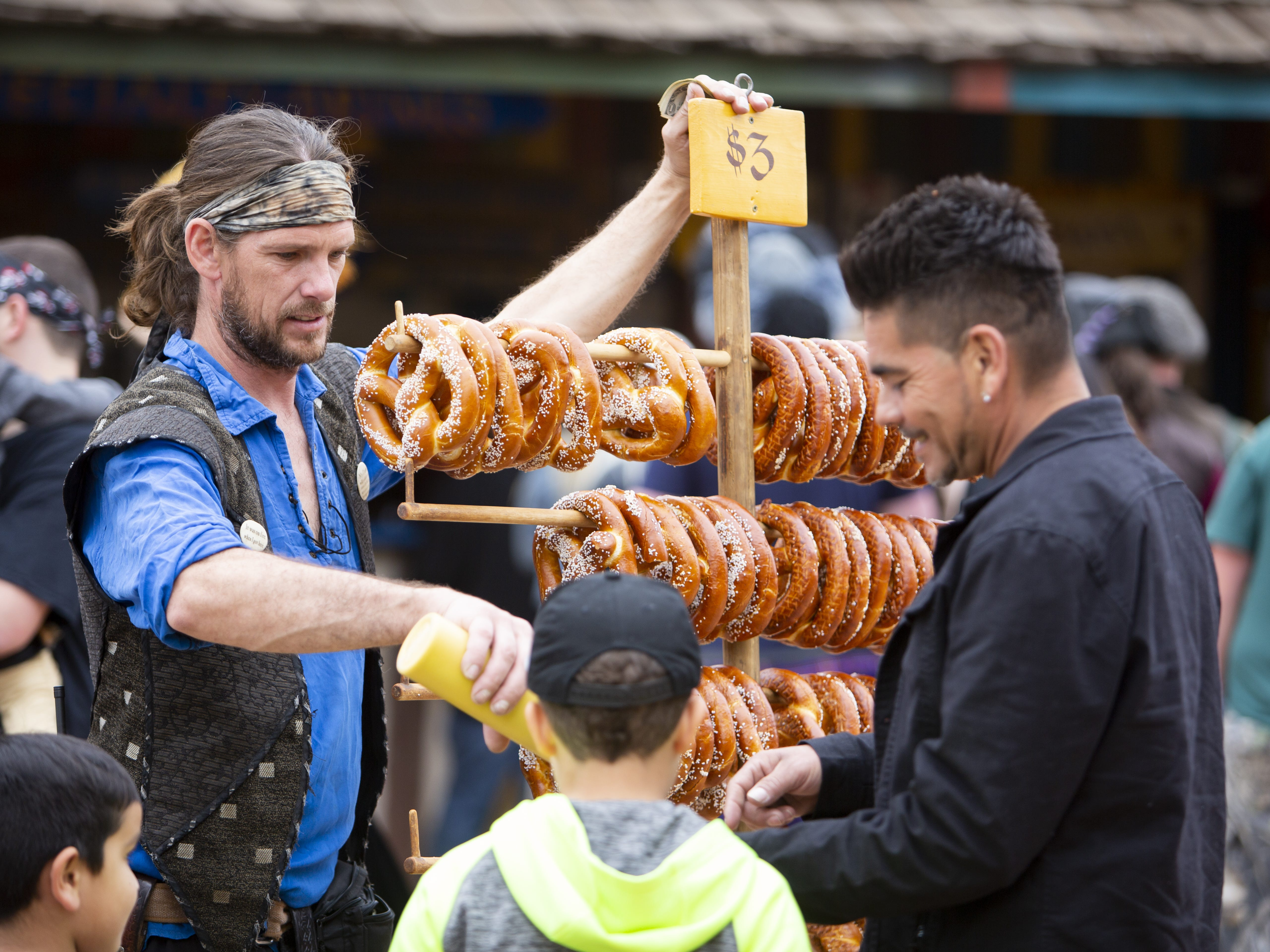 A man who identified himself as Black Ash the Pirate sells pretzels for $3 at the Arizona Renaissance Festival 2019 on Feb. 9, 2019 in Gold Canyon, Ariz.