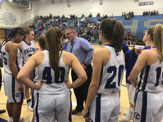 Cedar Crest girls basketball coach Jim Donmoyer speaks to his team prior to the second half of Saturday's L-L quarterfinal win over Lampeter-Strasburg.