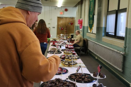 On Saturday, the Apostolic Restoration Center in Genoa hosted its 8th Annual Chocolate Lovers' Fest, a local fundraiser featuring 30-foot buffet with a seemingly endless supply of homemade cakes, candies, brownies, fudge, truffles and more.