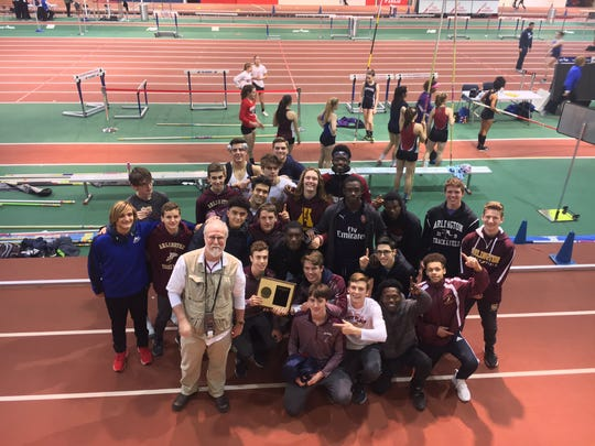 The Arlington High School boys track and field team poses after winning the Section 1 Class A title.