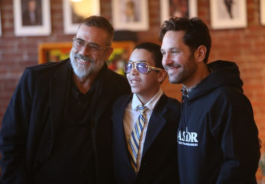 Jeffrey Dean Morgan and Paul Rudd pose for a photo with Arcadia before Ghost Stories 3 begins at Ulster Performing Arts Center in Kingston on February 9, 2019. Arcadia is a student at Astor Services and performed in the night's show.