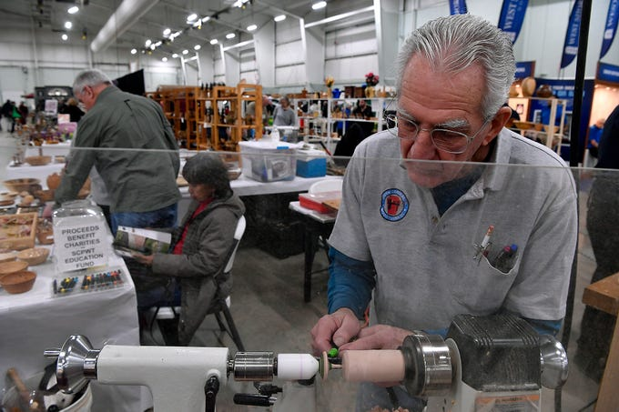 Phil Reed of Hallam, turns a wooden top at the South Centeral Woodturners display at the York Builders Association Home & Garden Show in the Utz Arena, Sunday, February 10, 2019.John A. Pavoncello photo