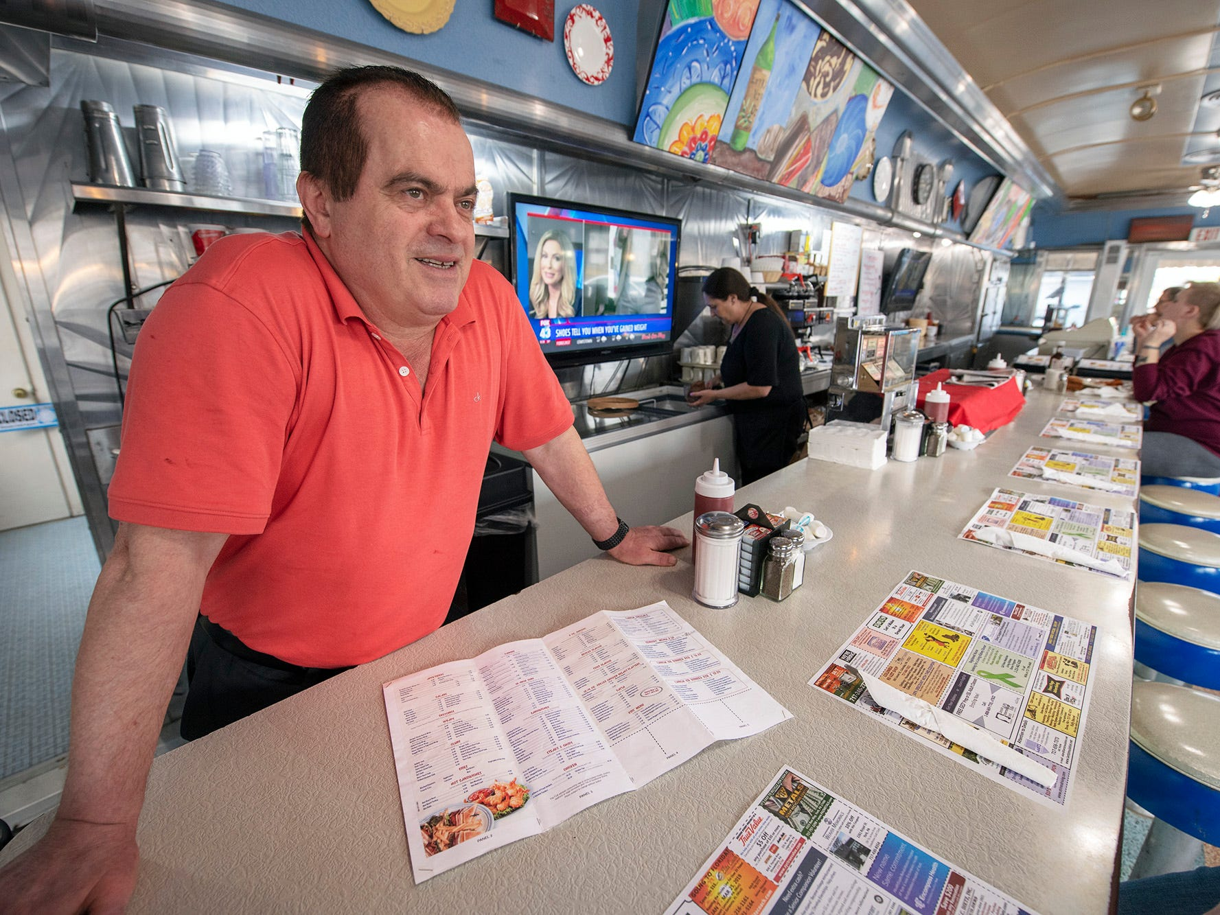 New business owner Teddy Petropoulos stands at the counter of the former Lee's Diner, now named Vicky's Diner. Changes include a new menu.