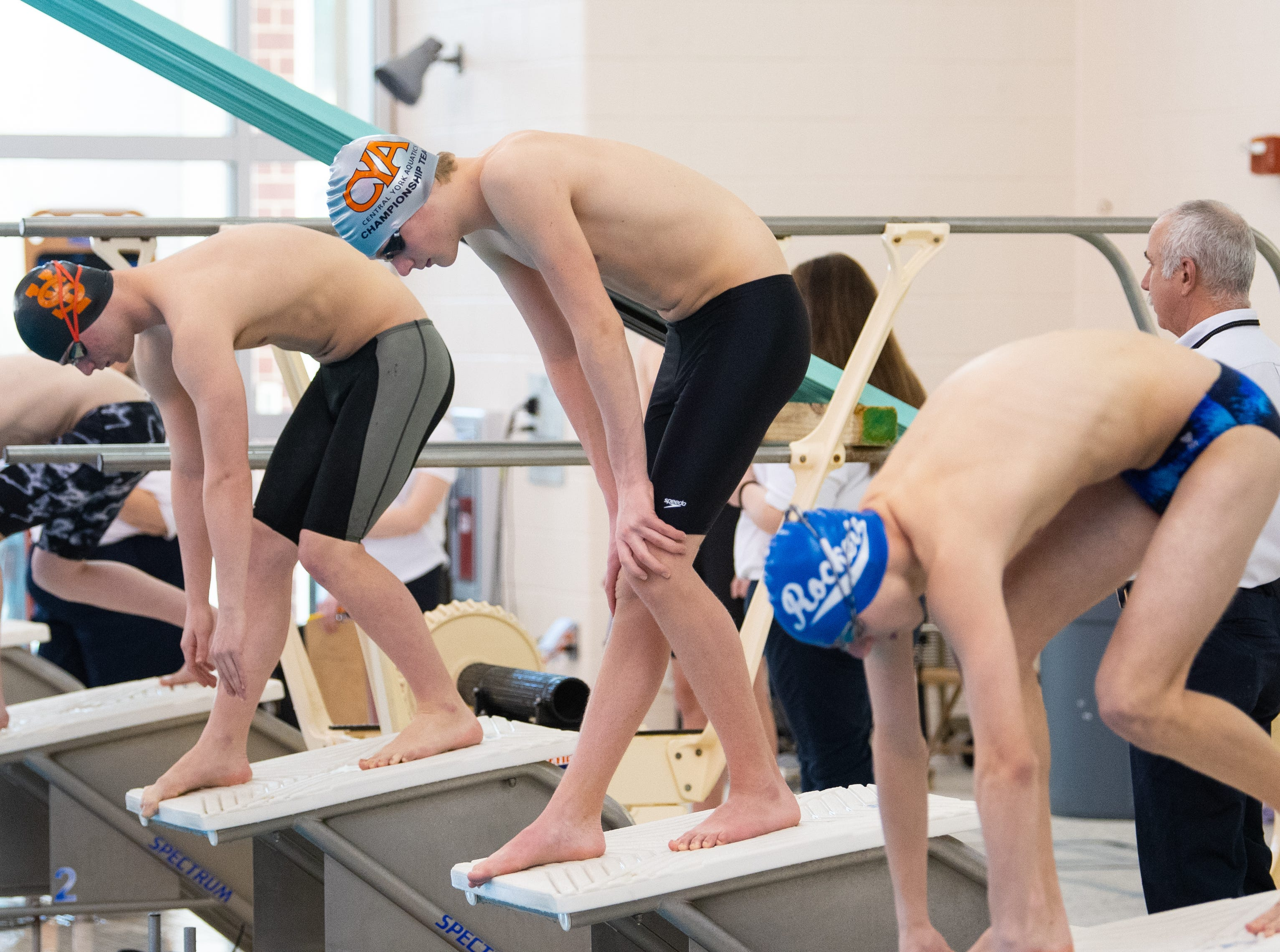 Swimmers prepare to start the Boys 500 Yard Freestyle during the 2019 YAIAA Swimming and Diving Championships at Central York High School, February 9, 2019.