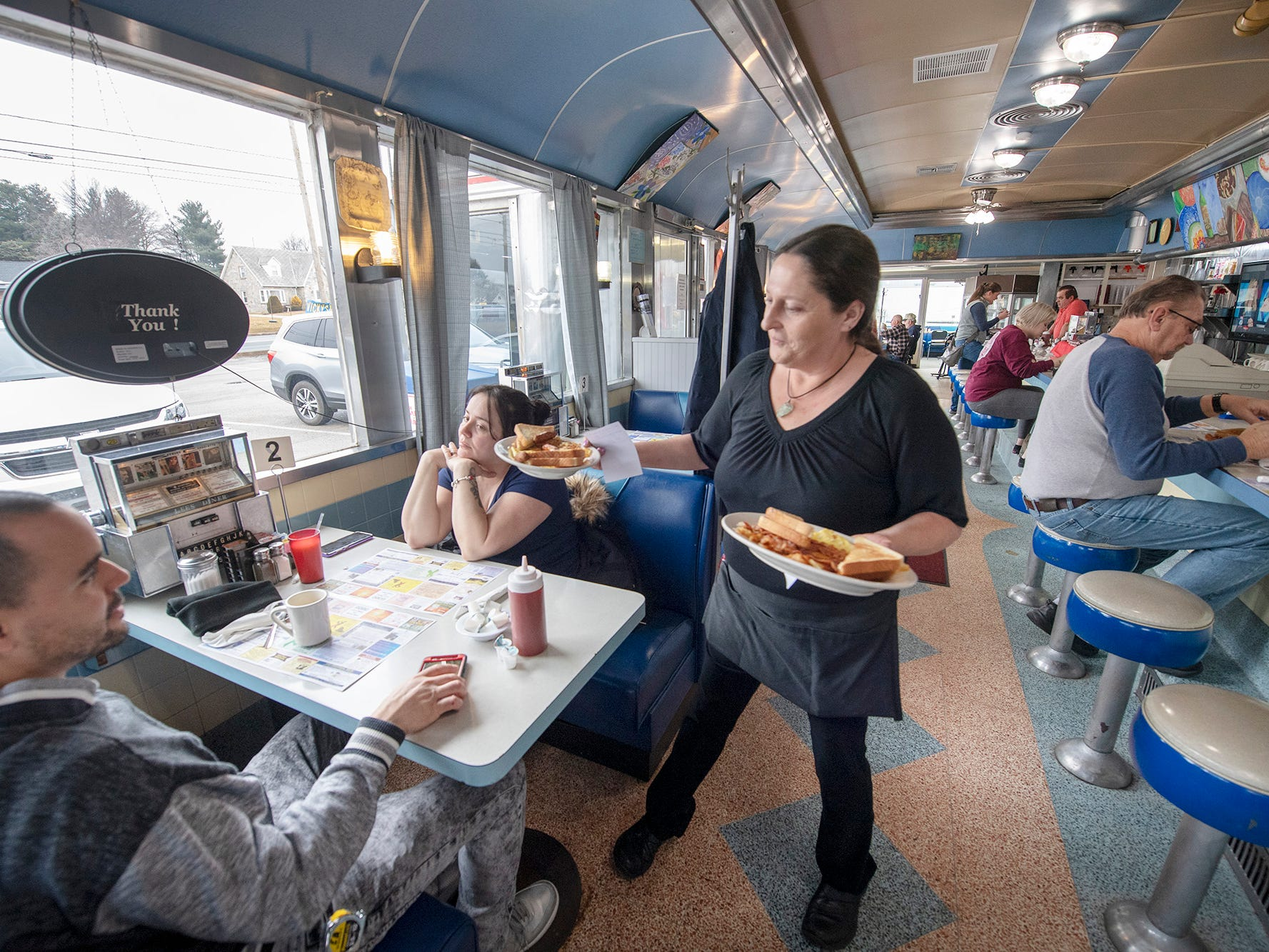 Manager Sherry Figard, right, brings out breakfast to customers at Vicky's Diner. The former Lee's Diner, in West Manchester Township, is under new ownership.