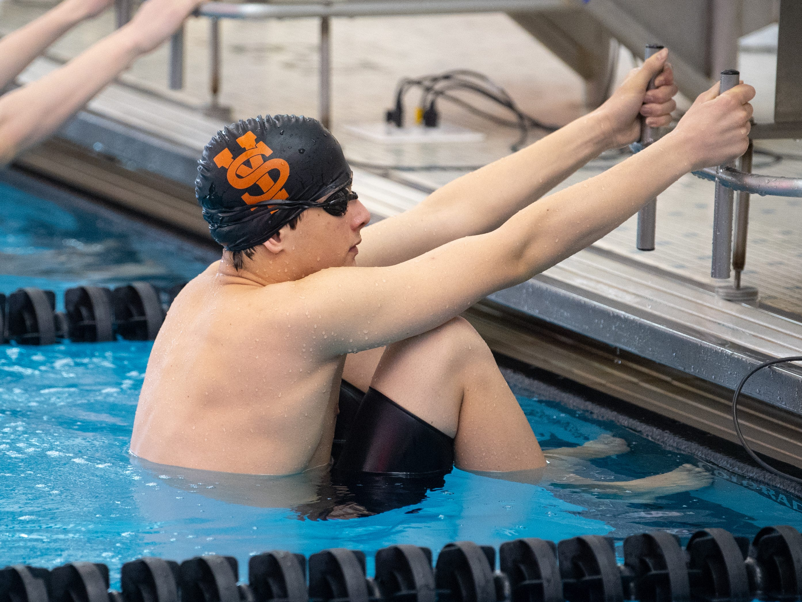 York Suburban's Nicholas Aparicio gets into position in the Boys 100 Yard Backstroke during the 2019 YAIAA Swimming and Diving Championships at Central York High School, February 9, 2019.