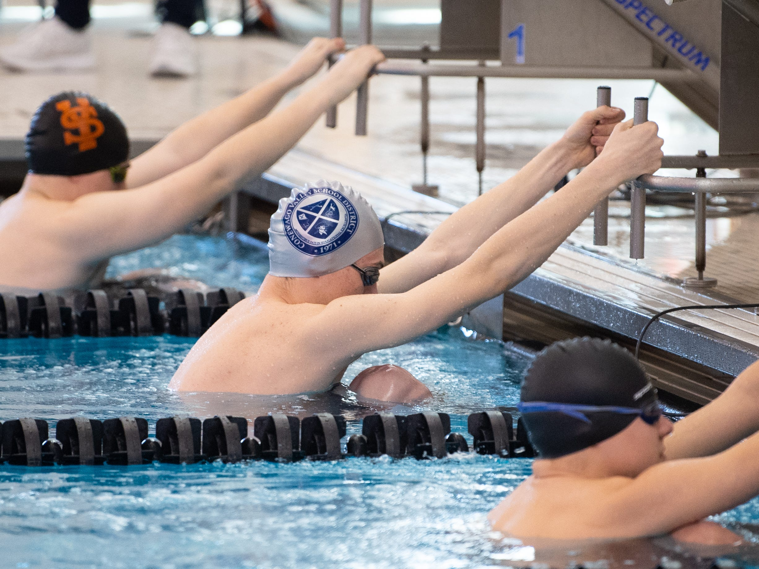 All competitors wait for the starting sound in the Boys 100 Yard Backstroke during the 2019 YAIAA Swimming and Diving Championships at Central York High School, February 9, 2019.