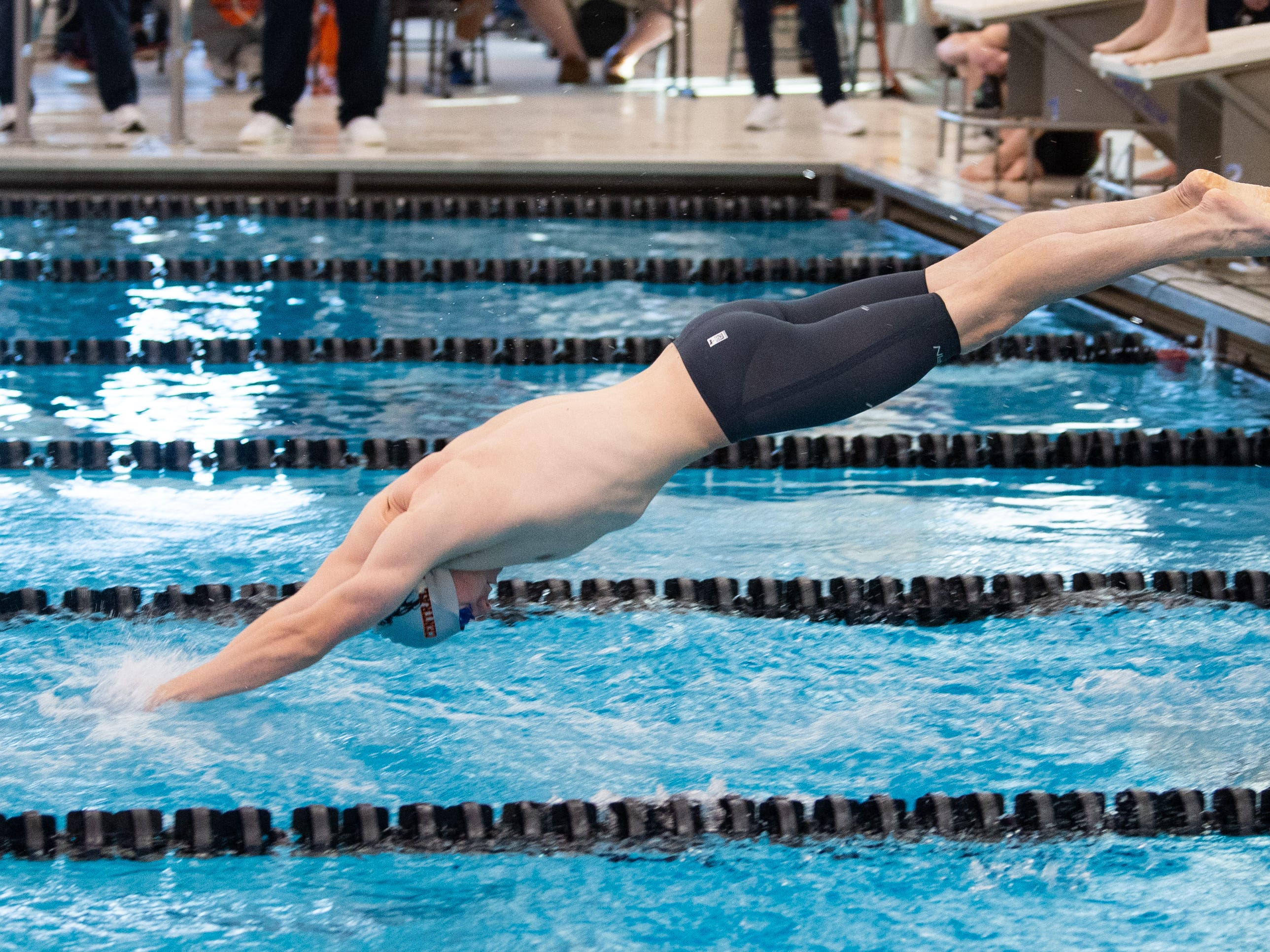 Central York's Nathan Dundas dives into the water during the Boys 400 Yard Freestyle Relay at the 2019 YAIAA Swimming and Diving Championships at Central York High School, February 9, 2019.
