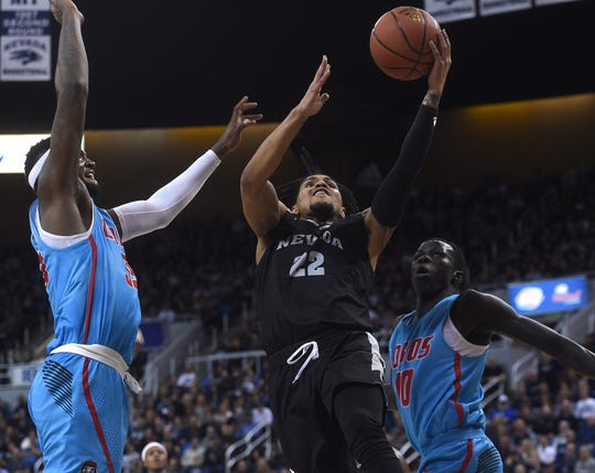 Nevada's Jazz Johnson drives to the basket against New Mexico on Saturday at Lawlor Events Center.