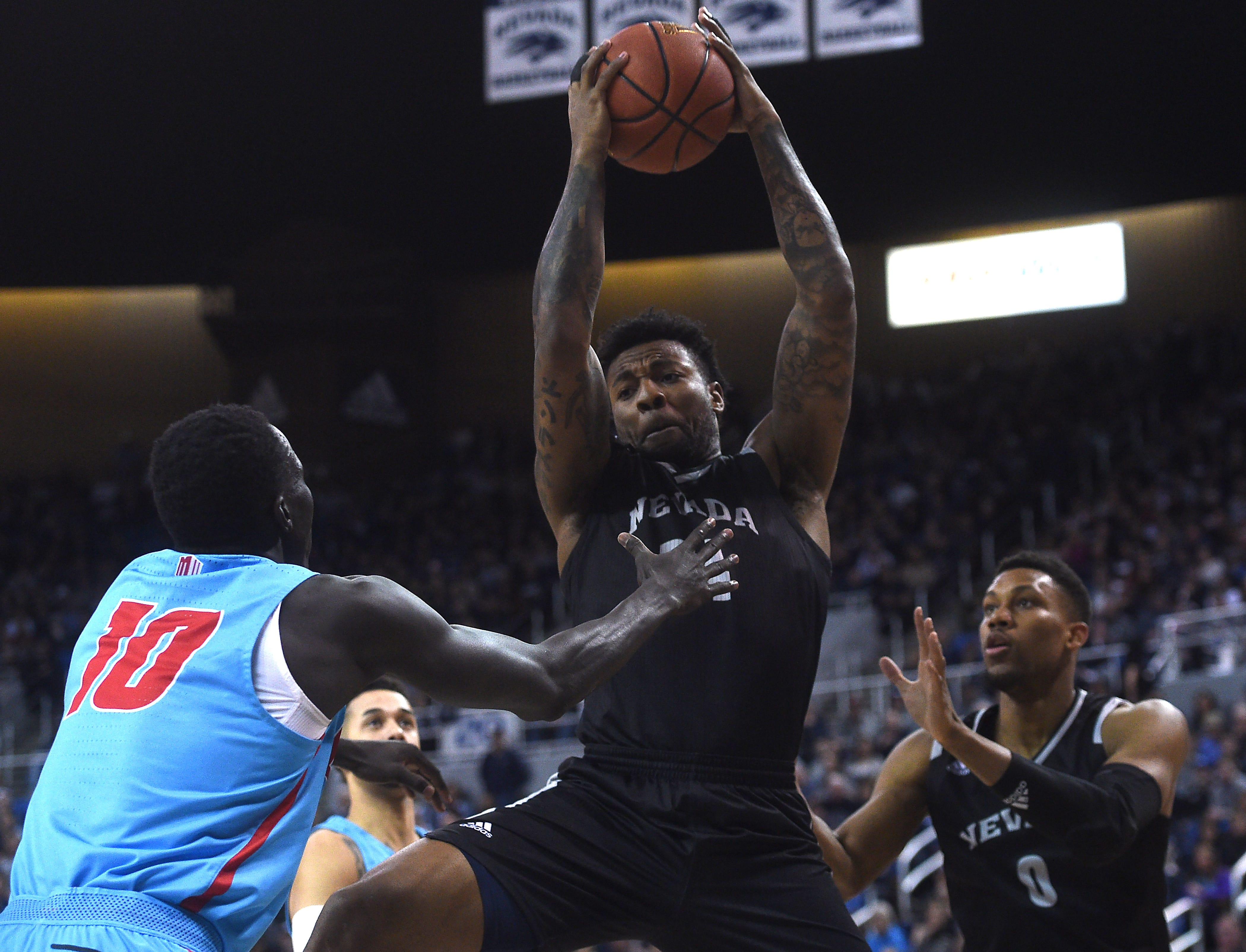 Nevada's Jordan Caroline grabs a rebound while taking on New Mexico at Lawlor Events Center in Reno on Feb. 9, 2019.