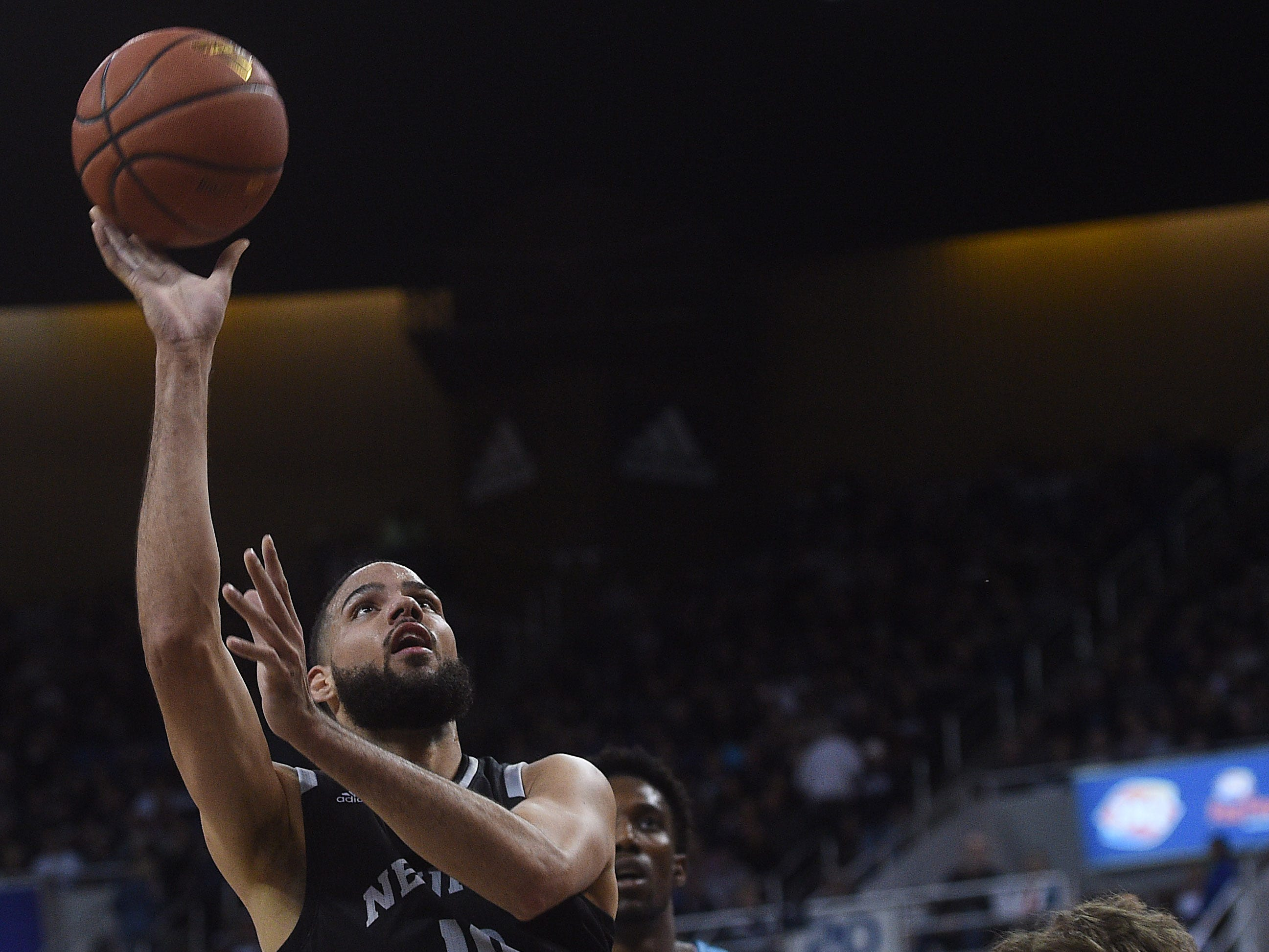 Nevada's Caleb Martin shoots while taking on New Mexico at Lawlor Events Center in Reno on Feb. 9, 2019.