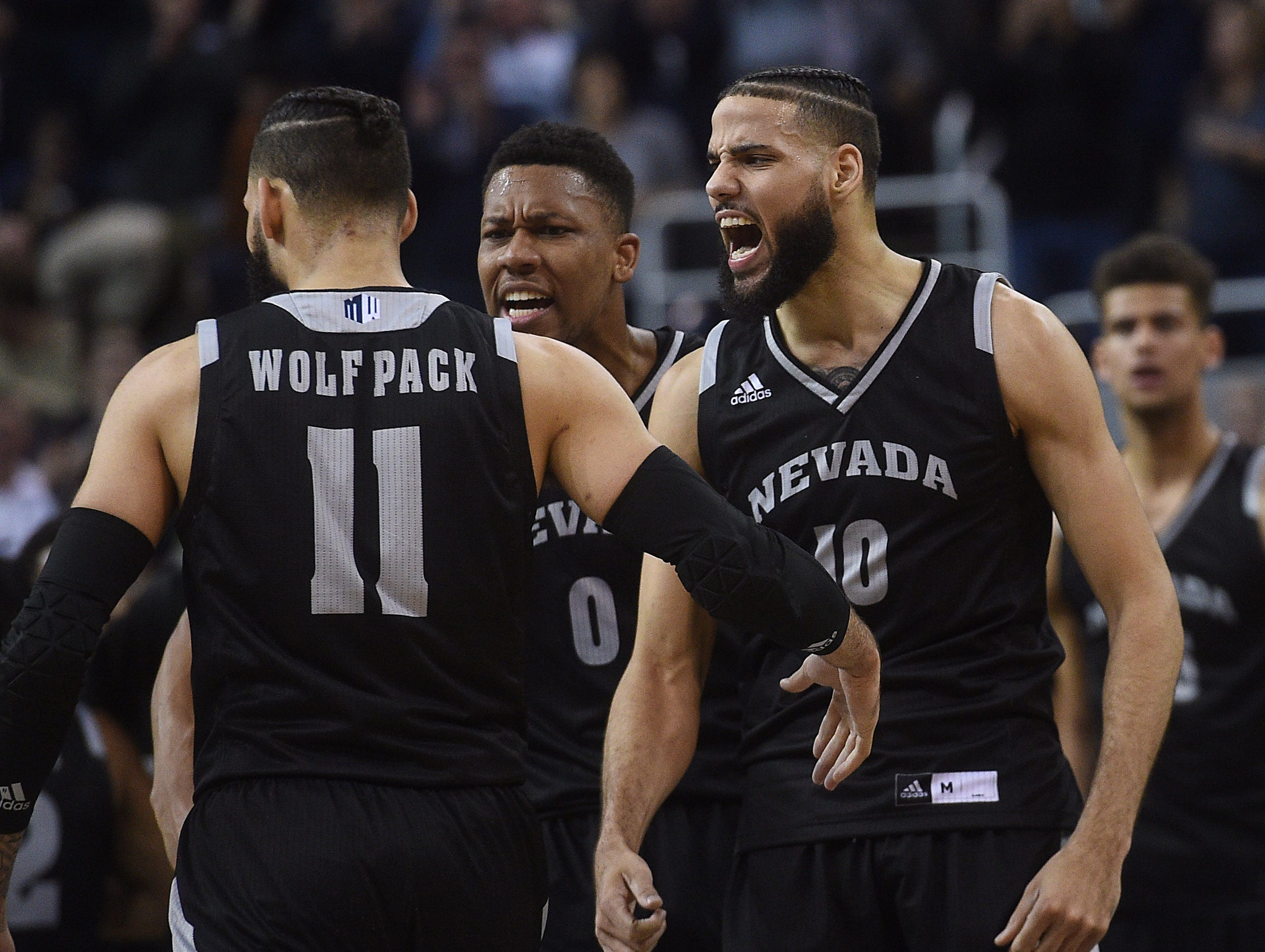 Nevada's Martin twins celebrate while taking on New Mexico at Lawlor Events Center in Reno on Feb. 9, 2019.