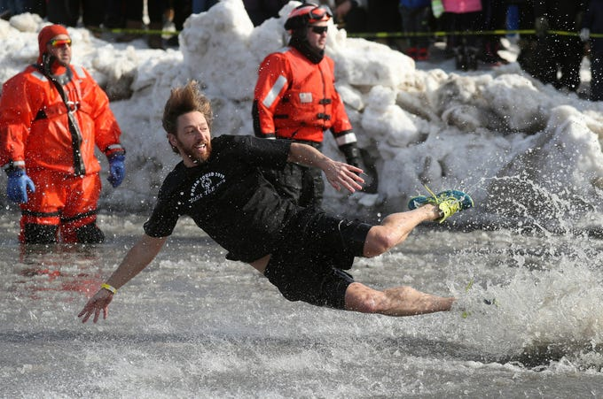 Joel McFarland, of Penfield, goes airborne as he jumps into Lake Ontario. McFarland was part of 2,000 people who took part int the annual Polar Plunge which raised more than $250,000 for Special Olympics of New York.