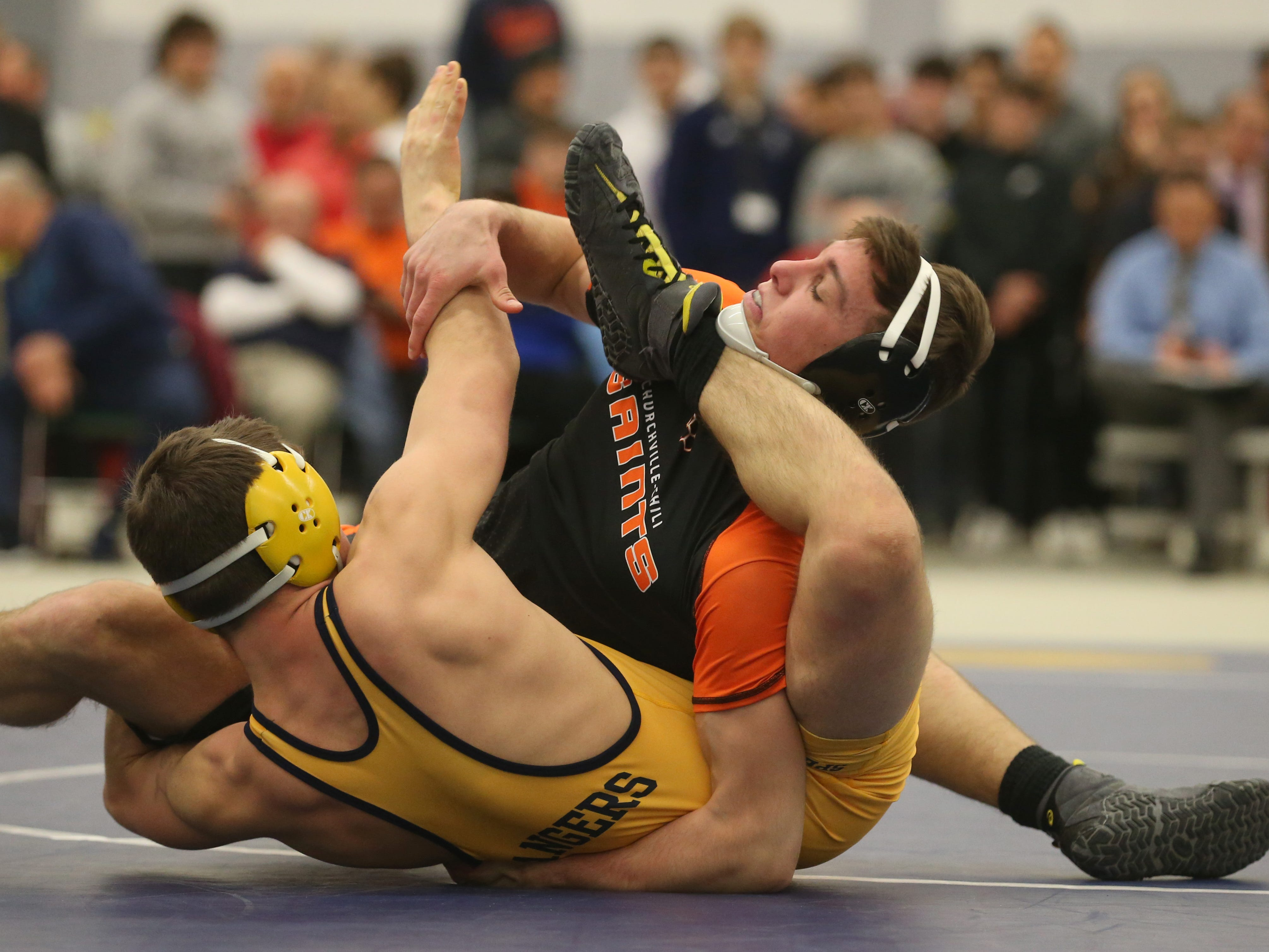 Churchville Chili's Ty Raines, right top, battles for position with Michael Vinci, Spencerport, in their Division 1, 152 pound match at the 52nd Annual State Wrestling Qualifier at the College at Brockport Saturday, Feb. 9, 2019.