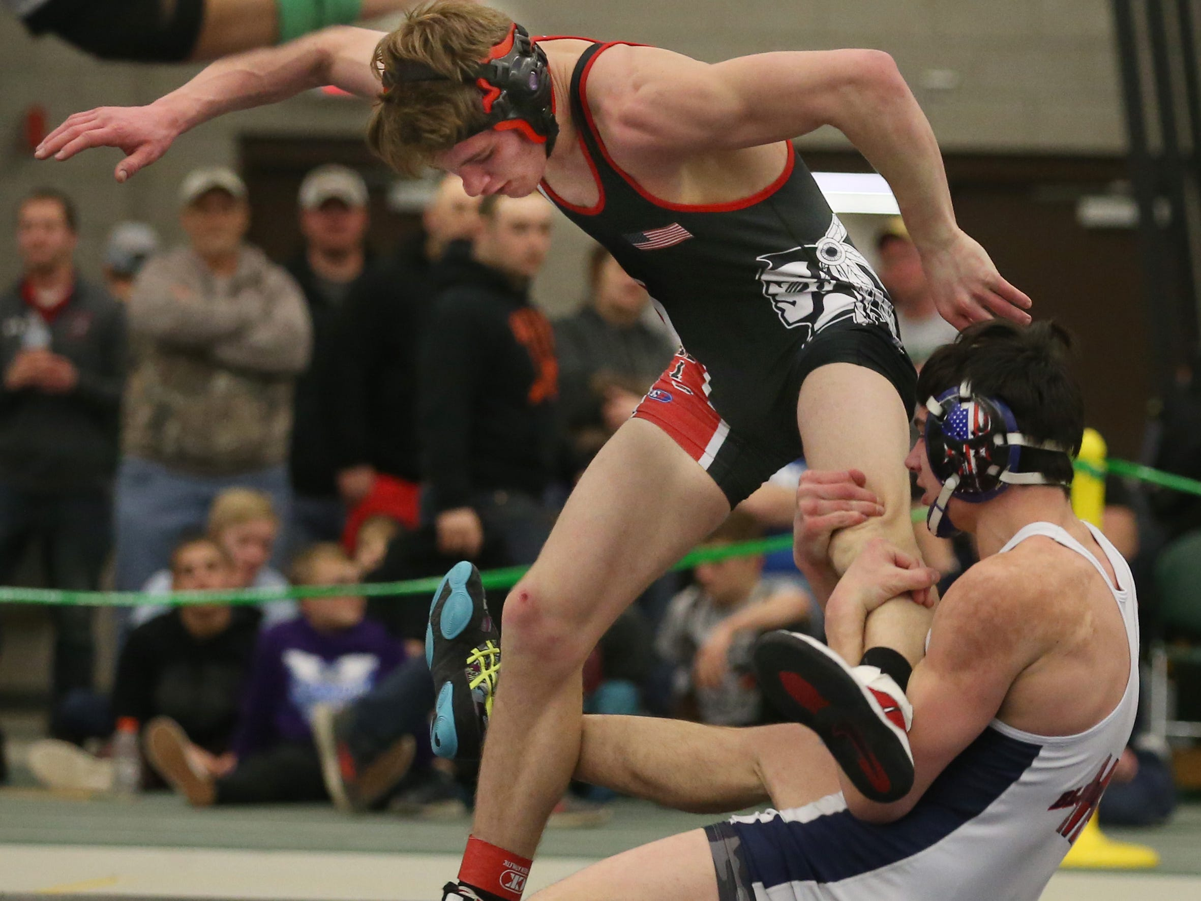 Mynderse's Trent Youngs, right, tries to take down Jonathan Davis, Canisteo-Greenwood, in their Division 2, 152 pound match at the 52nd Annual State Wrestling Qualifier at the College at Brockport Saturday, Feb. 9, 2019.