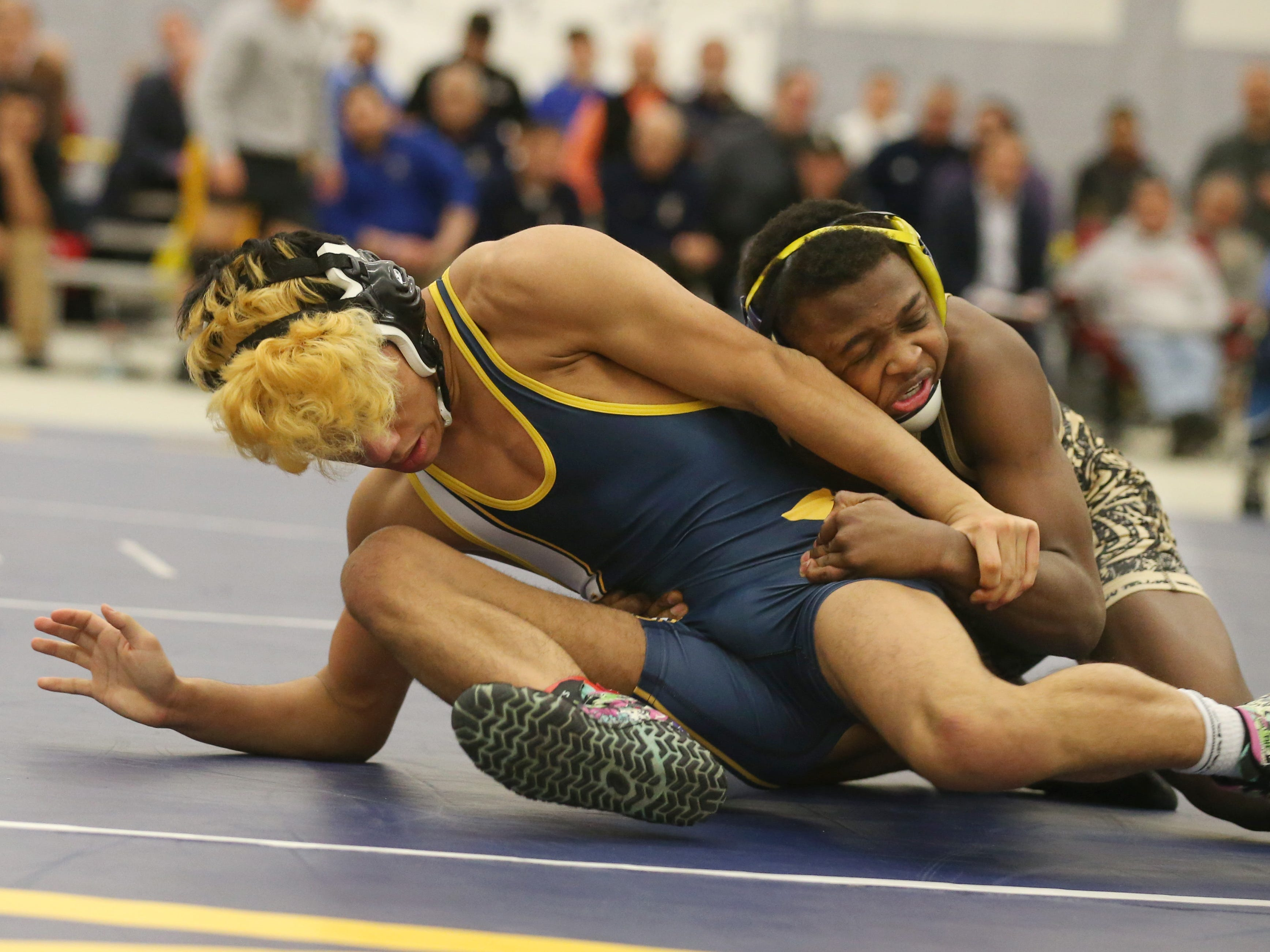 Rush Henrietta's Jayden Scott, right, ties up Cj Lee, Webster Thomas, in their Division 1, 120 pound match at the 52nd Annual State Wrestling Qualifier at the College at Brockport Saturday, Feb. 9, 2019.