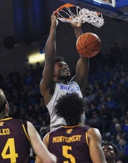Buffalo's Nick Perkins, top, dunks against Central Michigan during the second half of an NCAA college basketball game in Buffalo, N.Y., Saturday, Feb. 9, 2019. (AP Photo/Heather Ainsworth)