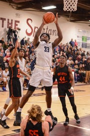 Rochester's Isaiah Stewart, who plays for La Lumiere prep school of Indiana, goes up for a shot. Stewart has accepted a basketball scholarship offer to the University of Washington.