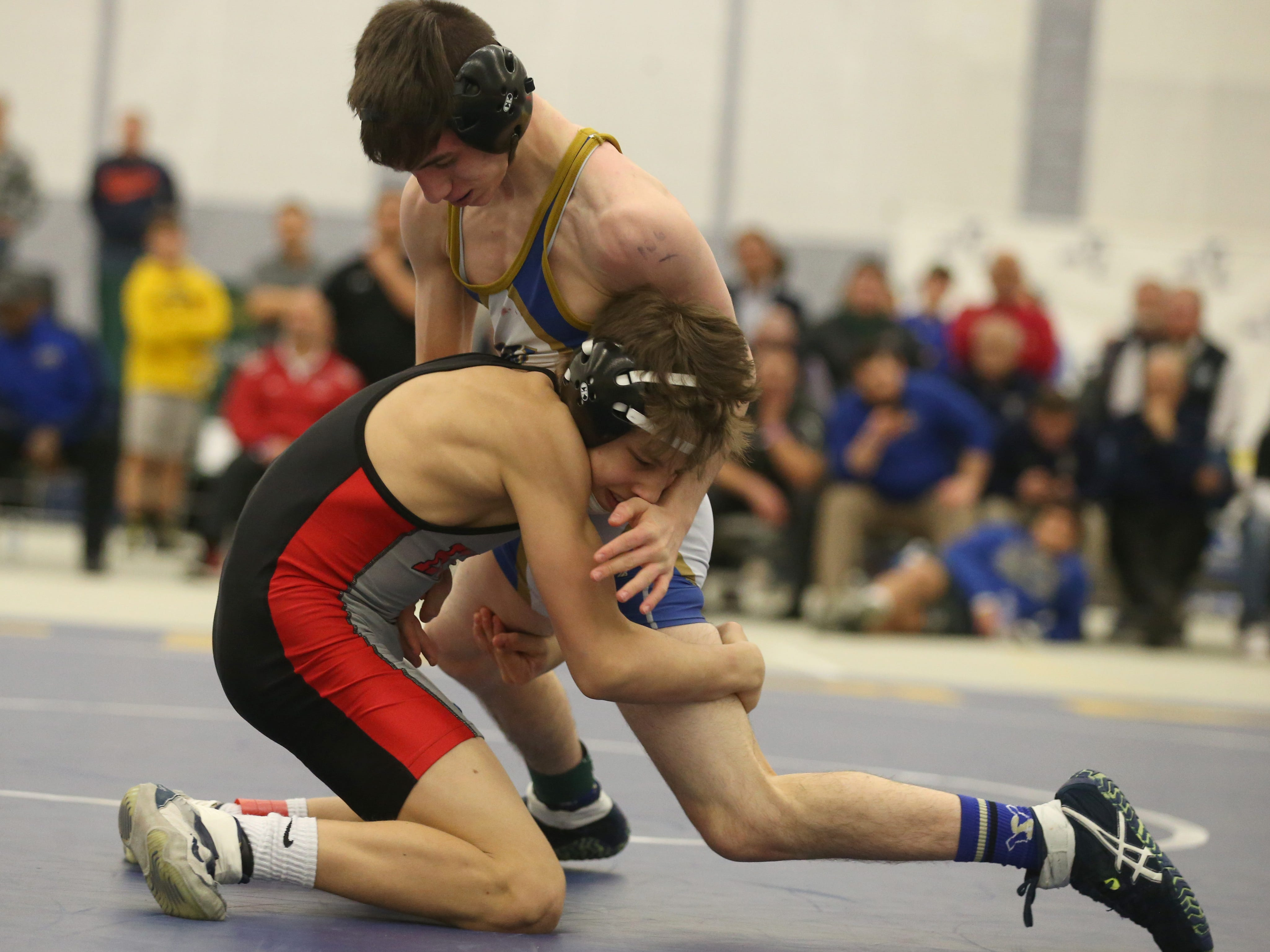 Hilton's Rocco Camillaci, bottom left, shoots in on Joe Berenson, Webster Schroeder, in their Division 1, 106 pound match at the 52nd Annual State Wrestling Qualifier at the College at Brockport Saturday, Feb. 9, 2019.