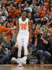 Syracuse's Tyus Battle celebrates after scoring a basket during the second half of an NCAA college basketball game against Boston College in Syracuse, N.Y., Saturday, Feb. 9, 2019. Syracuse won 67-56.