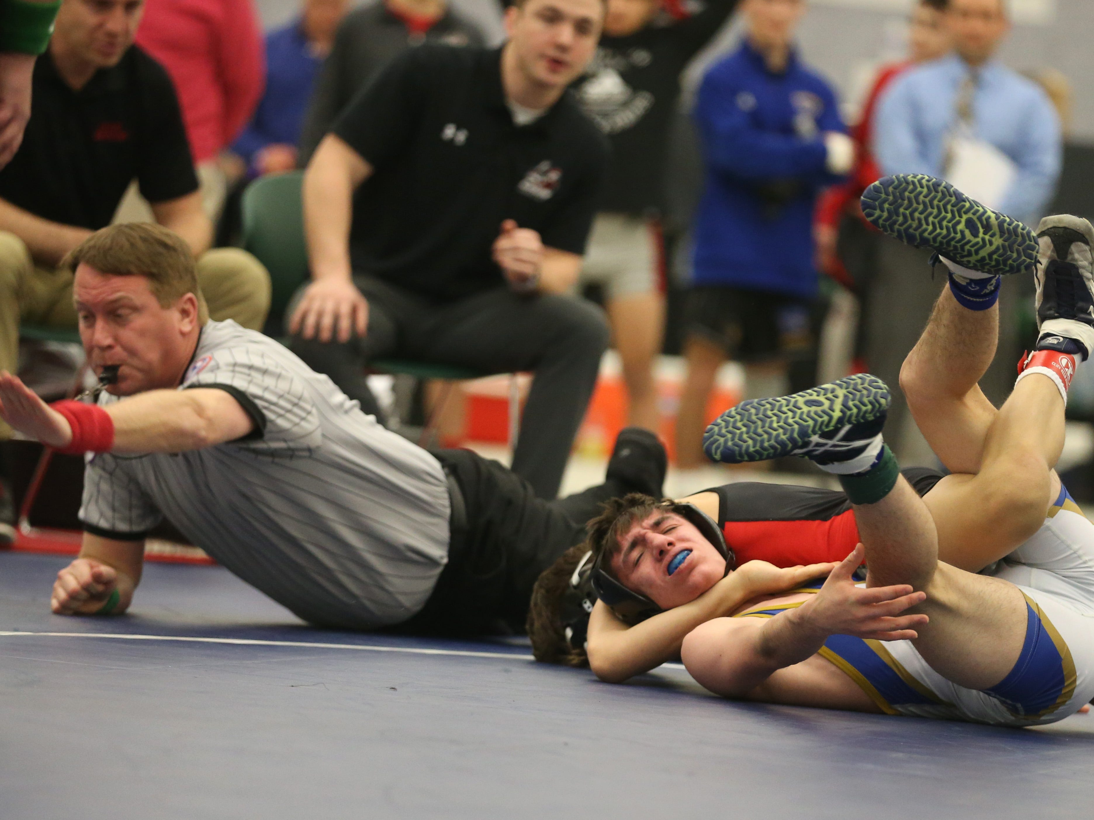 Hilton's Rocco Camillaci, top, pins Joe Berenson, Webster Schroeder, in their Division 1, 106 pound match at the 52nd Annual State Wrestling Qualifier at the College at Brockport Saturday, Feb. 9, 2019.
