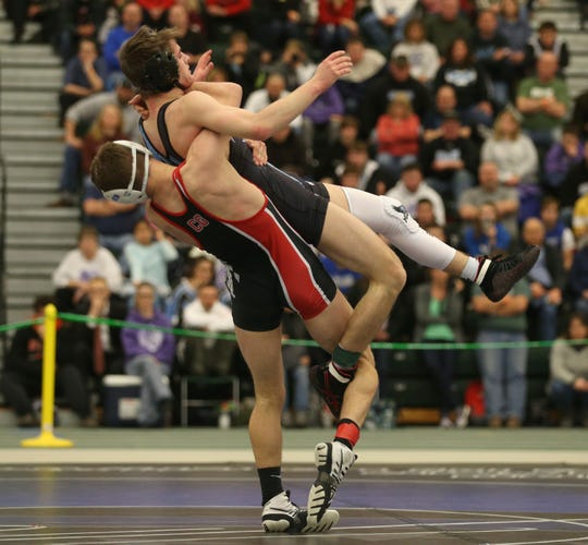 Canisteo-Greenwood's Bradley Cheek, left, lifts and takes down Brandon MacDonell, Midlakes, in their Division 2, 126 pound match at the 52nd Annual State Wrestling Qualifier at the College at Brockport Saturday, Feb. 9, 2019.