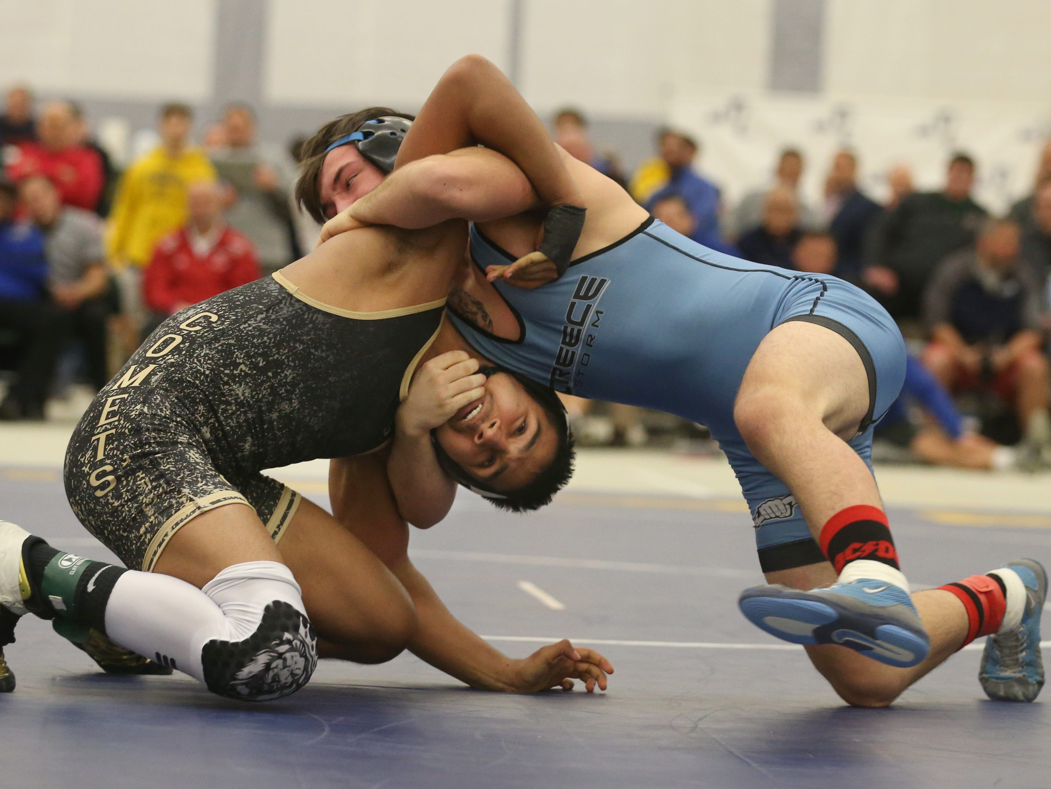 Greece's Dillon Callaghan, right top, ties up with Karamvir Hothi, Rush Henrietta, in their Division 1, 145 pound match at the 52nd Annual State Wrestling Qualifier at the College at Brockport Saturday, Feb. 9, 2019.
