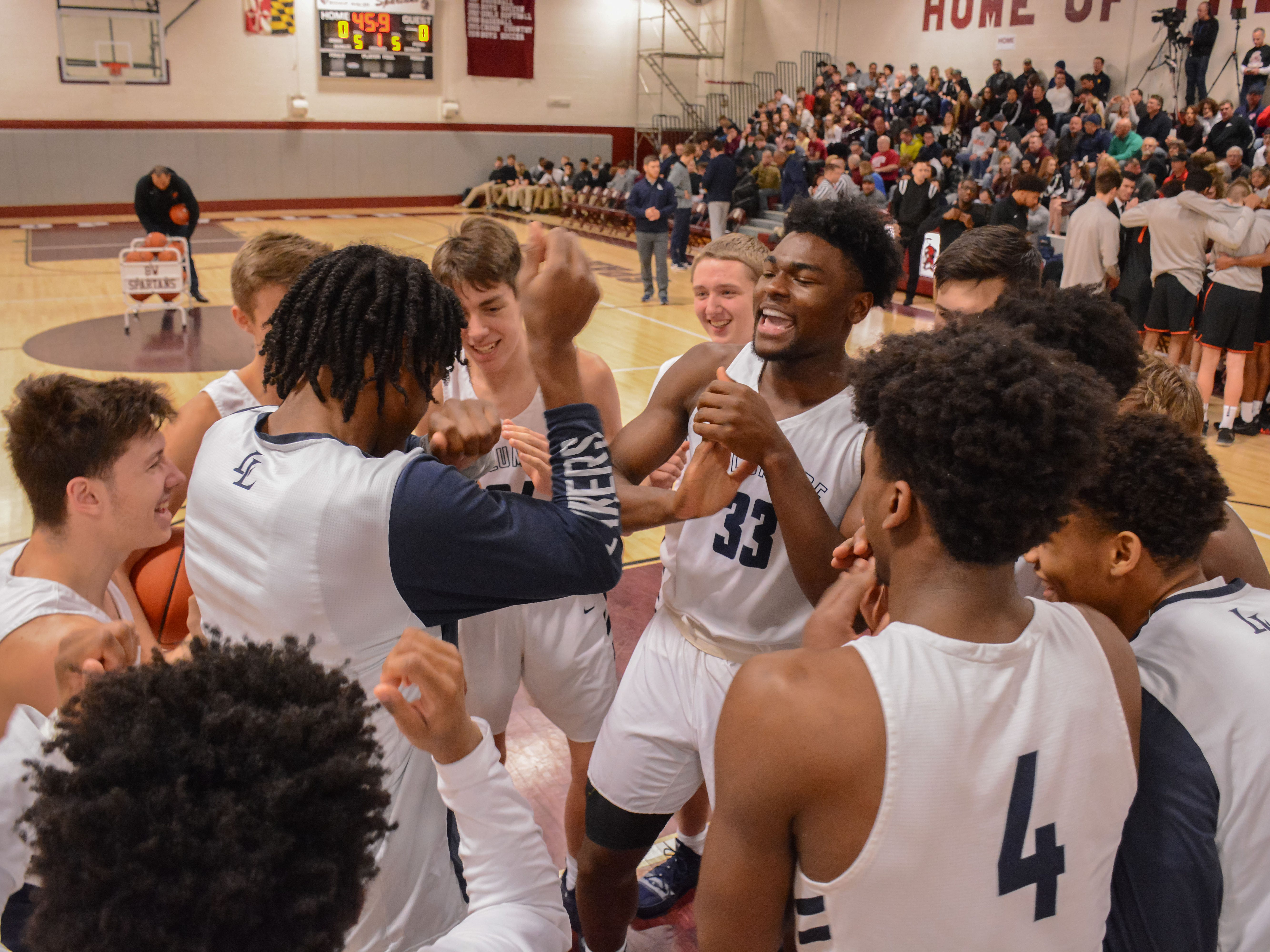 Former McQuaid star Isaiah Stewart (33) gets fired up with his La Lumiere teammates prior to a game against Wasatch Academy of Utah at the Bob Kirk Invitational in Cumberland, Maryland.