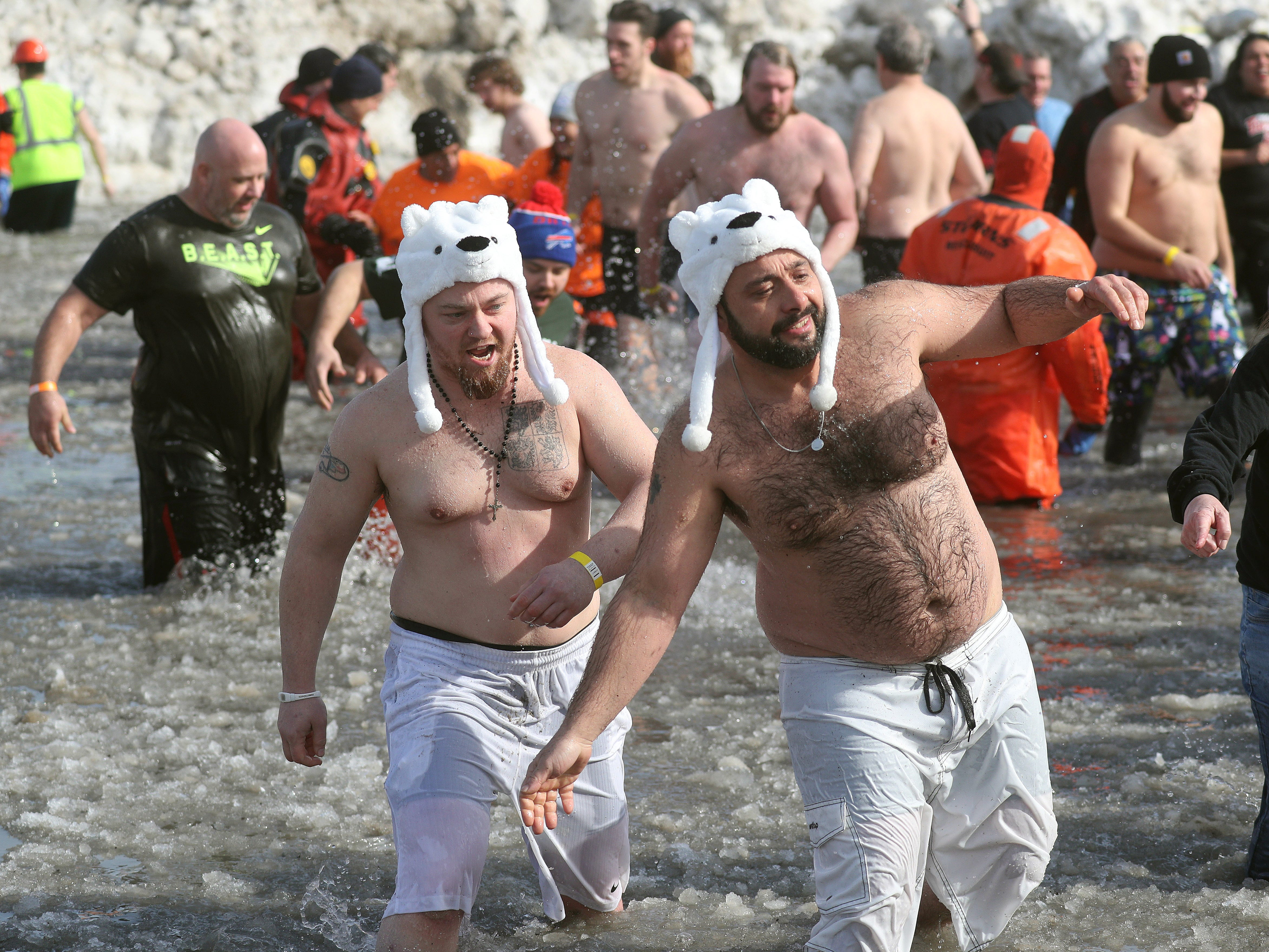 Some of the 2,000 people who took the plunge into Lake Ontario as part of the annual Polar Plunge.  The event raised more than $250,000 for Special Olympics of New York.