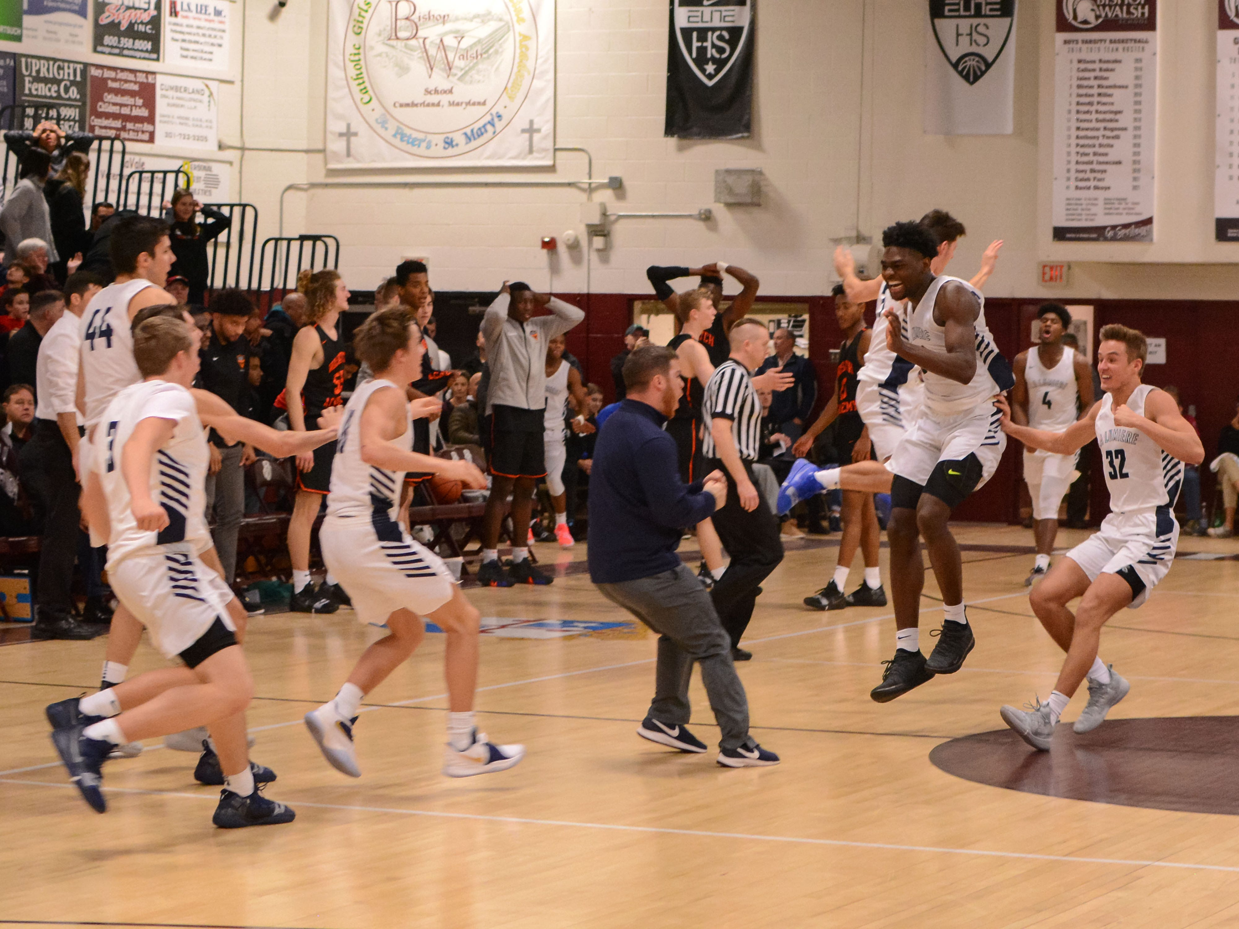 Members of the La Lumiere basketball team, which is ranked No. 1 in the country, including Isaiah Stewart (33) and Gerald Drumgoole (4), celebrate their 53-52 win over Wasatch Academy of Utah during the Bob Kirk Invitational in Cumberland, Maryland.