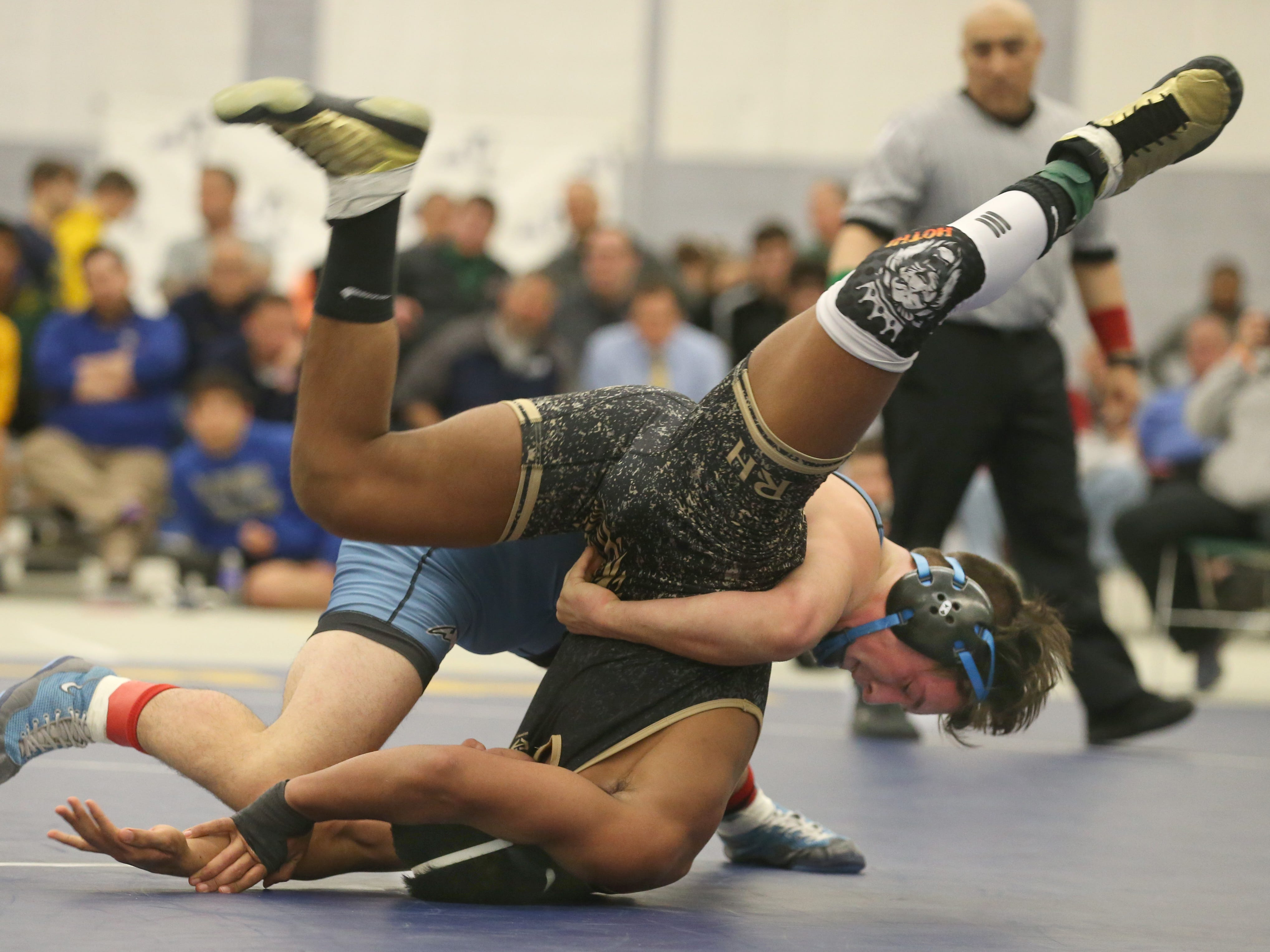 Greece's Dillon Callaghan, right top, flips Karamvir Hothi, Rush Henrietta, in their Division 1, 145 pound match at the 52nd Annual State Wrestling Qualifier at the College at Brockport Saturday, Feb. 9, 2019.