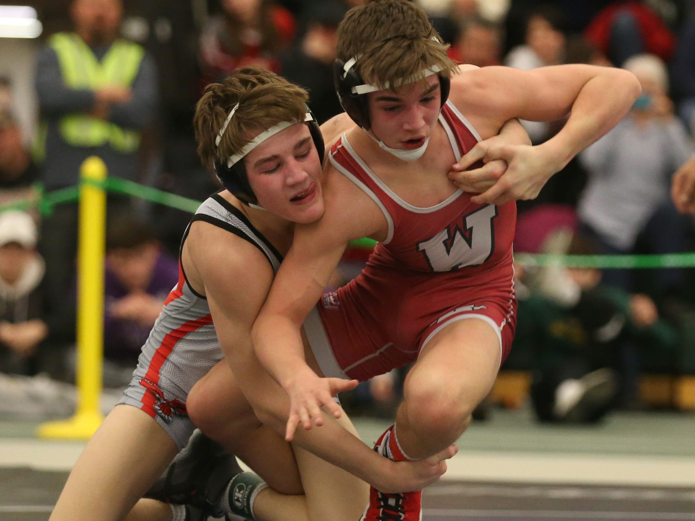 Pal-Mac's Kaleb Burgess, left, tires to tie up Carter Schubert, Williamson/Marion/Sodus, in their Division 2, 120 pound match at the 52nd Annual State Wrestling Qualifier at the College at Brockport Saturday, Feb. 9, 2019.