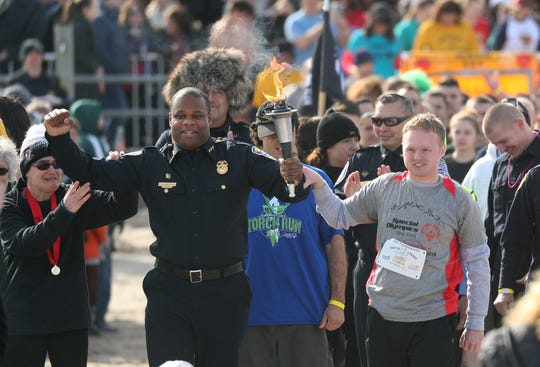 Rochester Police Deputy Chief La'Ron Singletary carried the torch at the start of the annual Polar Plunge back in February at Charlotte Beach.