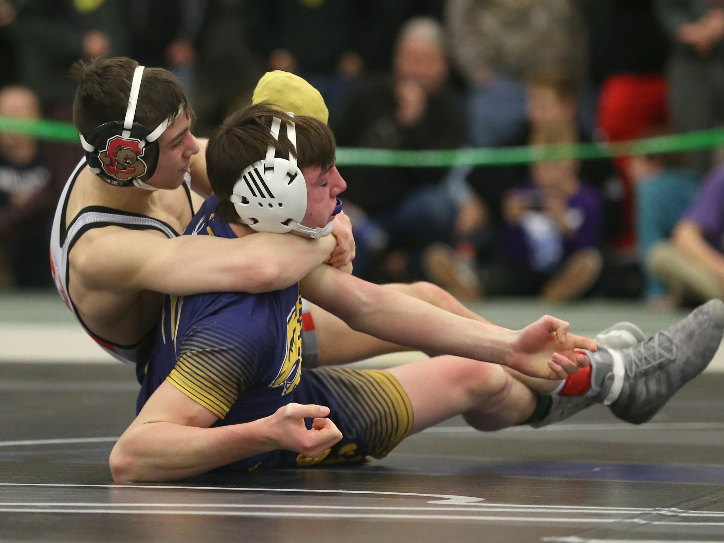 Pal-Mac's Ethan Ferro, left, rolls back Justin Smith, Penn Yan/Marcus Whitman, for back points, in their Division 2, 132 pound match at the 52nd Annual State Wrestling Qualifier at the College at Brockport Saturday, Feb. 9, 2019.