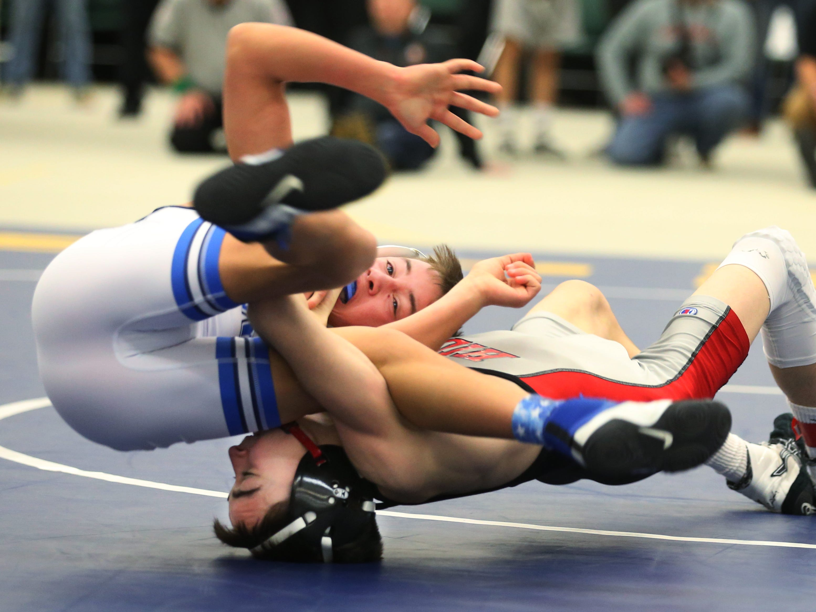 Hilton's Gregor McNeil, right, takes down Casper Stewart, Attica/Batavia, in their Division 1 99 pound match at the 52nd Annual State Wrestling Qualifier at the College at Brockport Saturday, Feb. 9, 2019.