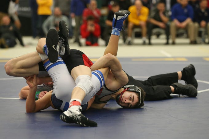 Hilton's Gregor McNeil, right, goes for the pin on Casper Stewart, Attica/Batavia, in their Division 1 99 pound match at the 52nd Annual State Wrestling Qualifier at the College at Brockport Saturday, Feb. 9, 2019.
