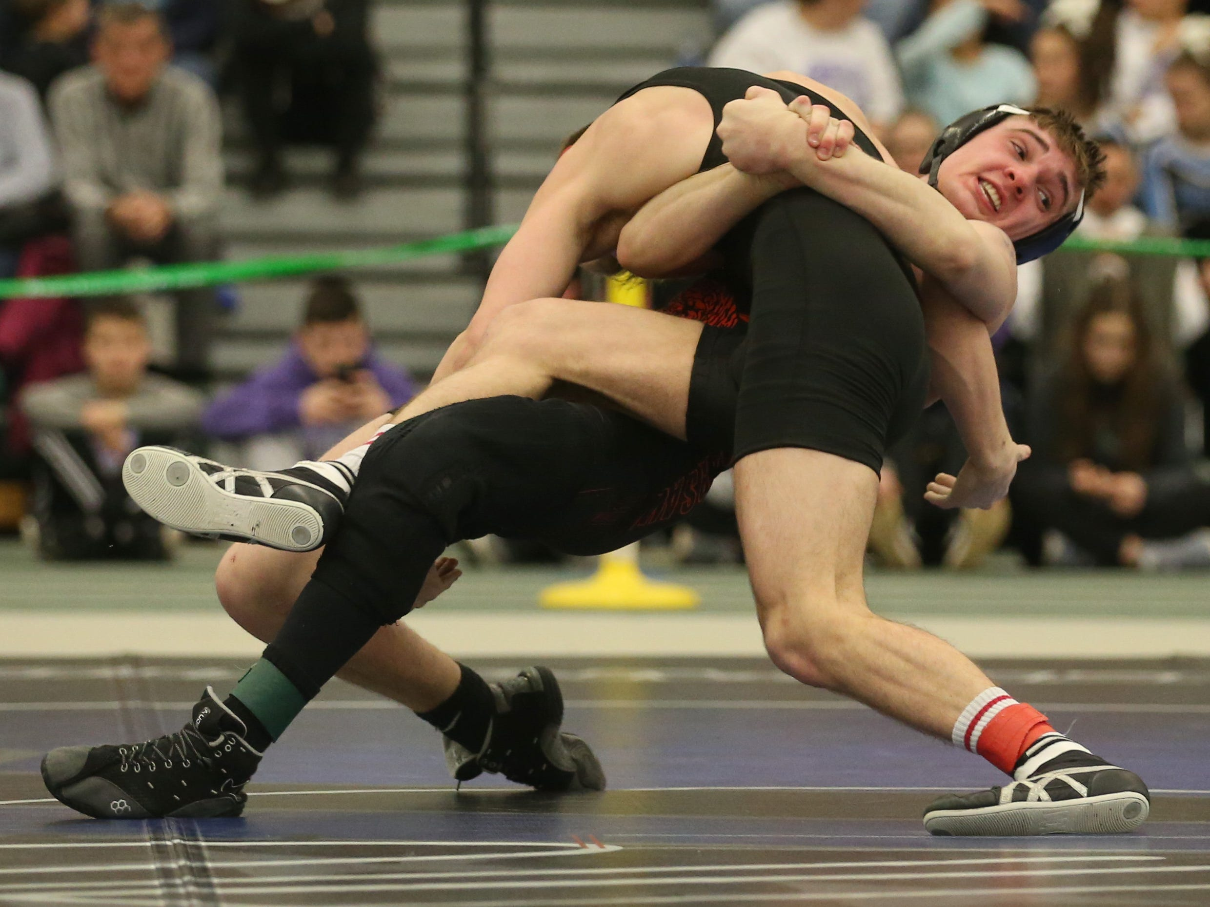 Warsaw's Nathan Murphy, right, goes for a spinning take down on Leroy's Andrew Englerth, in their Division 2, 138 pound match at the 52nd Annual State Wrestling Qualifier at the College at Brockport Saturday, Feb. 9, 2019.