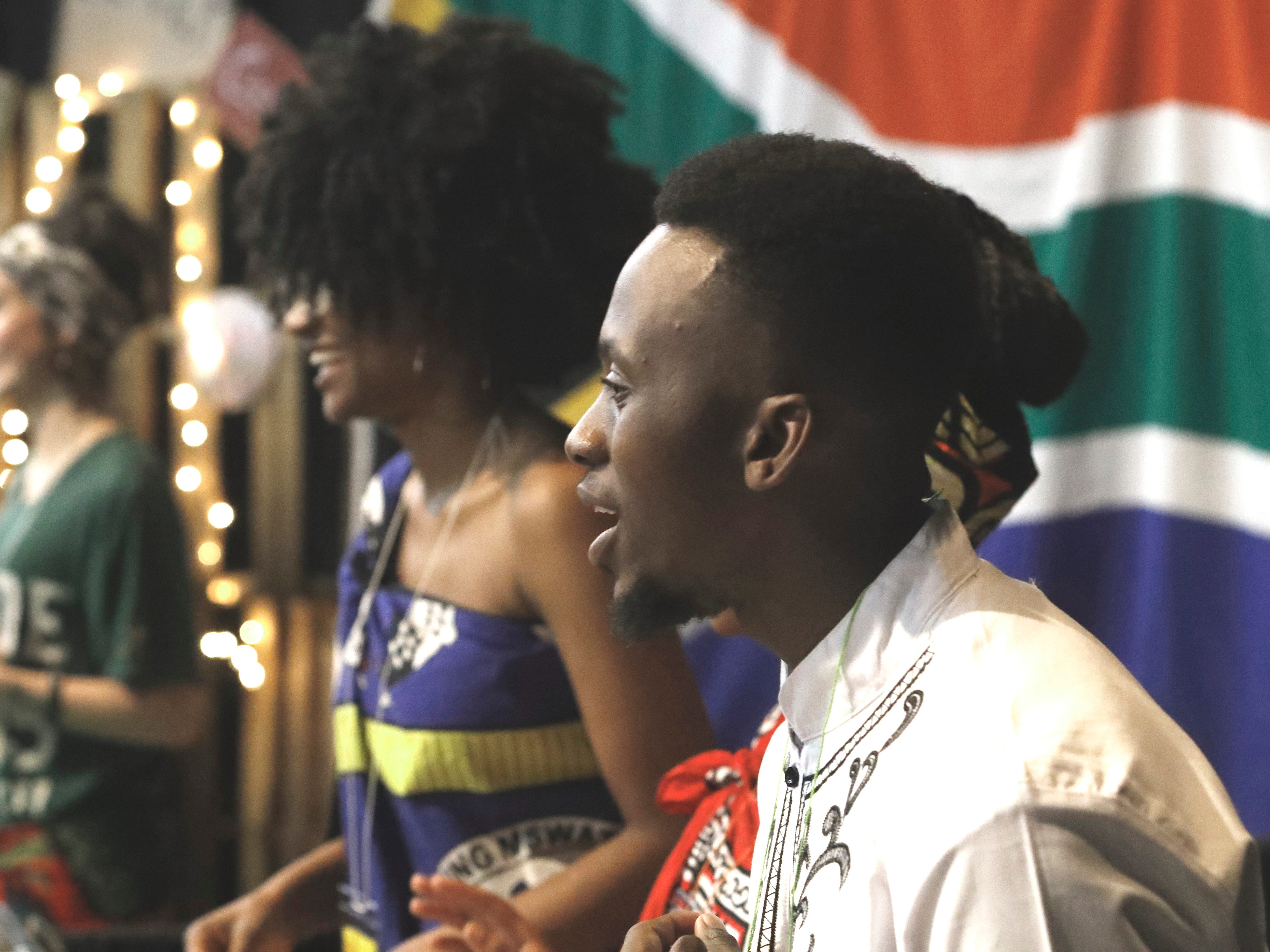 Tendo Chawane of Swaziland greets guests at his country's table during the 10th annual Festival of Cultures hosted by Bethel Church in the Redding Civic Auditorium on Feb. 9, 2019.