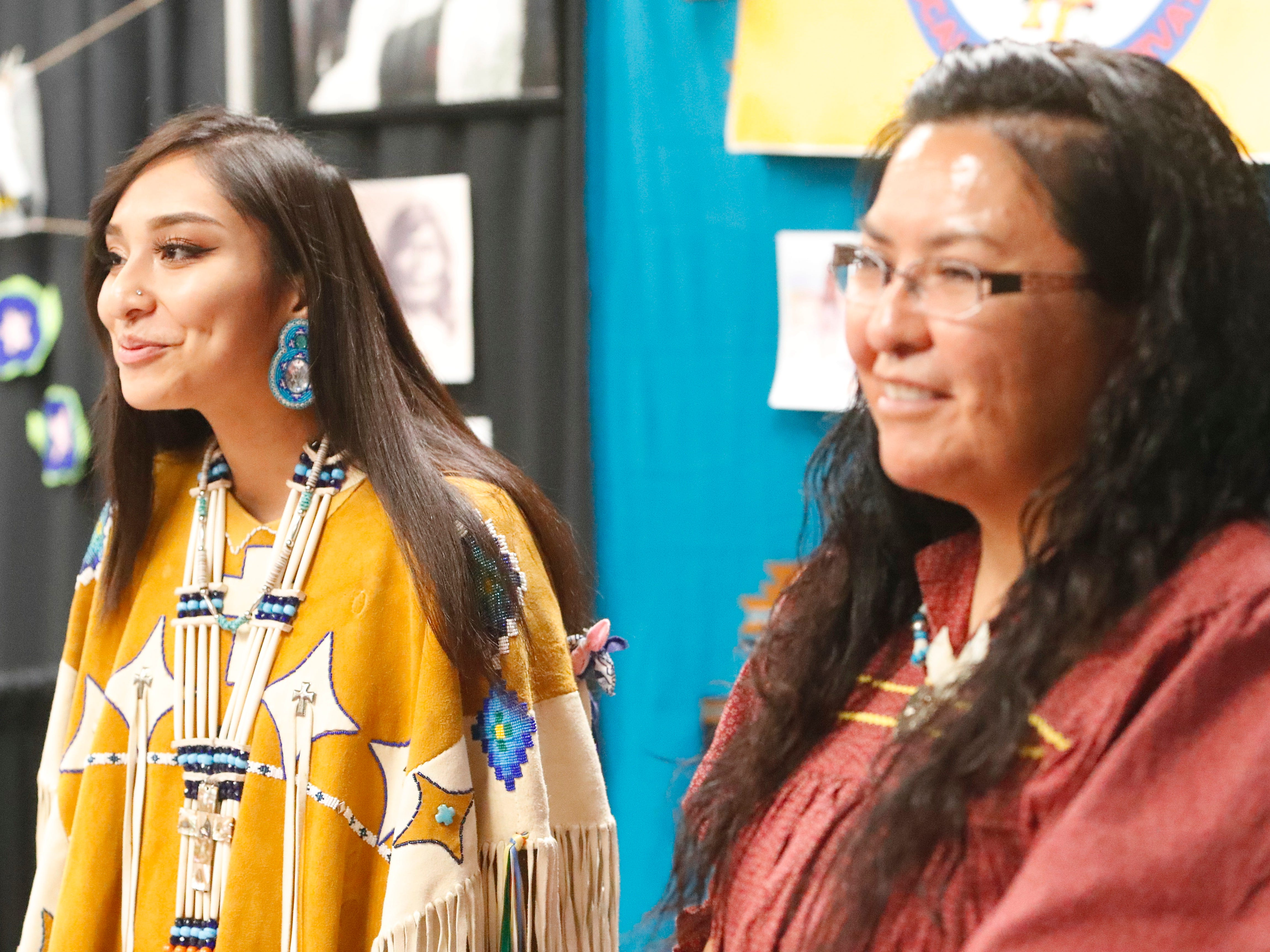 Trinity Enjady, left, and Janice Merino greet visitors to their Mescalero Apache booth during the Festival of Cultures hosted by Bethel Church on Feb. 9, 2019.