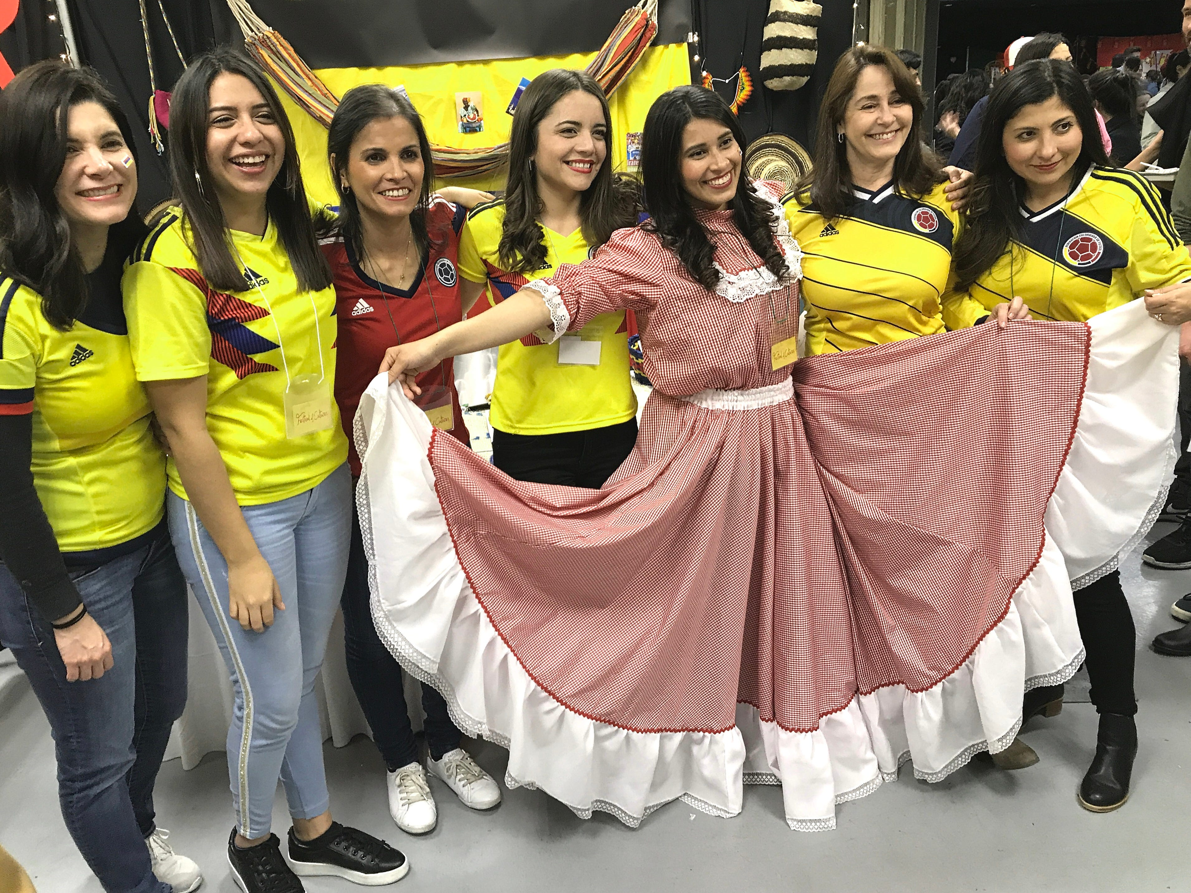 Bethel School of Supernatural Ministry students pose in front of the Colombia table during the annual Festival of Cultures in the Redding Civic Auditorium on Feb. 9, 2019.