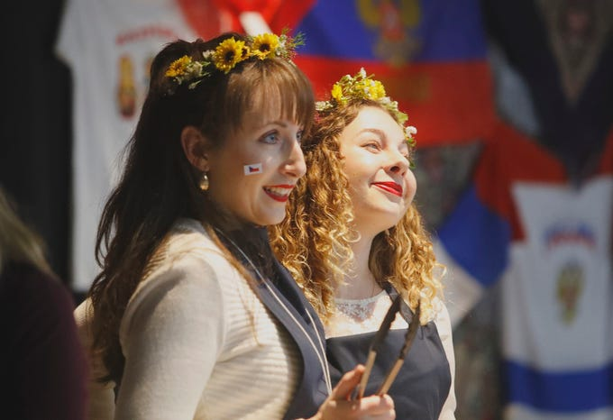 Noemi Follerova, left, and Tereza Lindenthalova serve trdelnik, a wedding pastry, at the Czech Republic booth during the Festival of Cultures hosted by Bethel Church on Feb. 9, 2019.