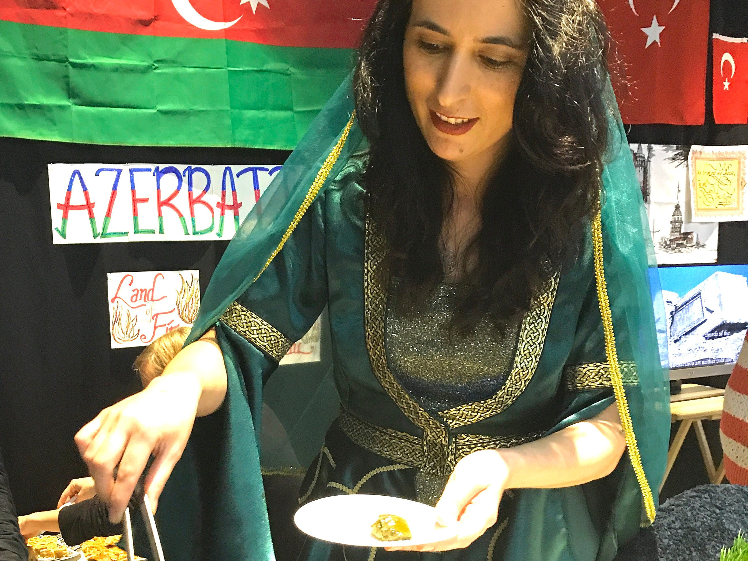 Sevda Turajova of Azerbaijan serves a native dish of dolma made with grape leaves during the Festival of Cultures hosted by Bethel Church on Feb. 9, 2019, in the Redding Civic Auditorium.