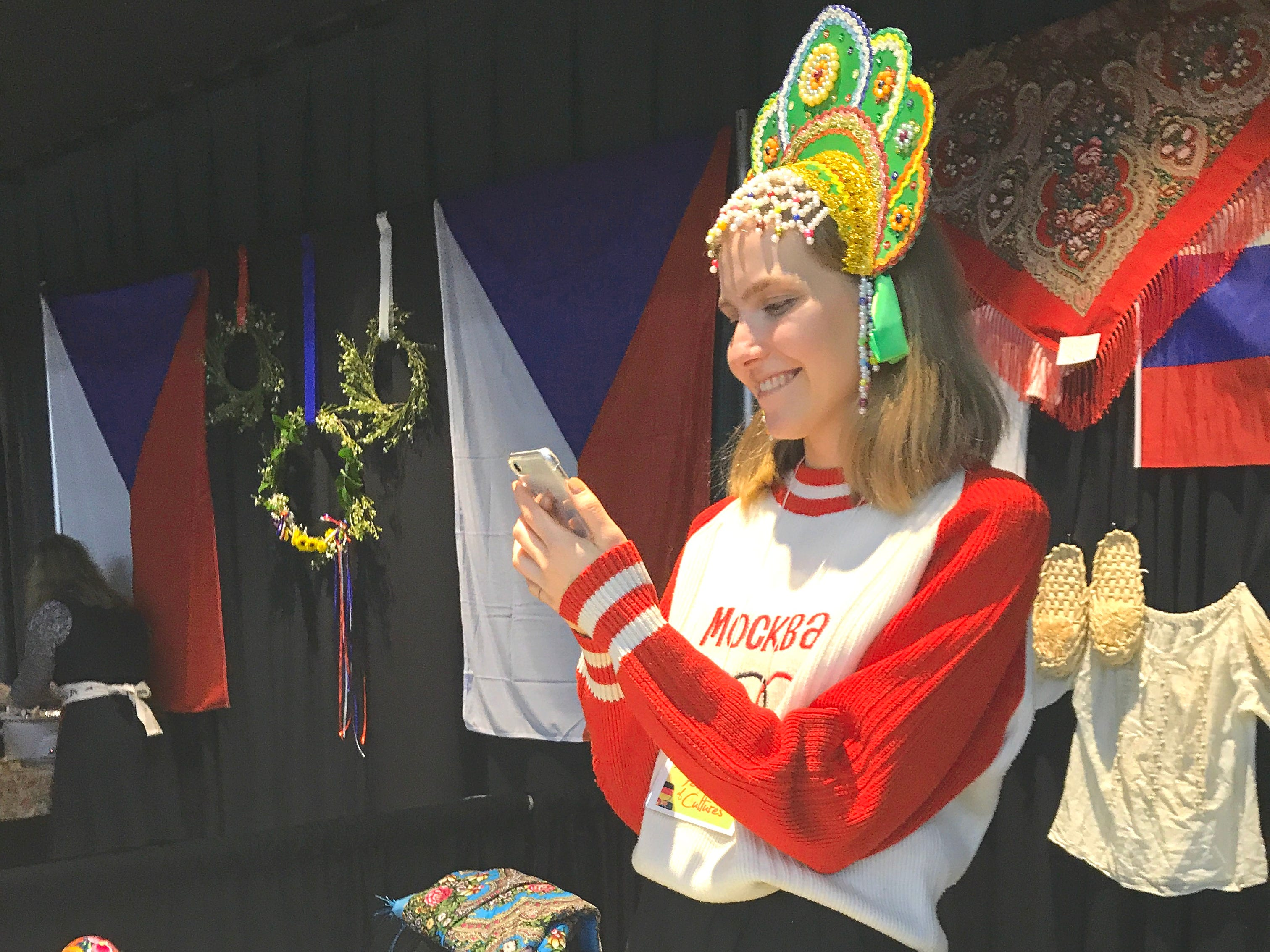 Maria Belyakova of Russia gets ready to serve samples of her country's potato salad that also had eggs, pickles, peas and Russian bologna. She and other international students from the Bethel School of Supernatural Ministry participated in the 10th annual Festival of Cultures hosted by the church in the Redding Civic Auditorium on Feb. 9, 2019.